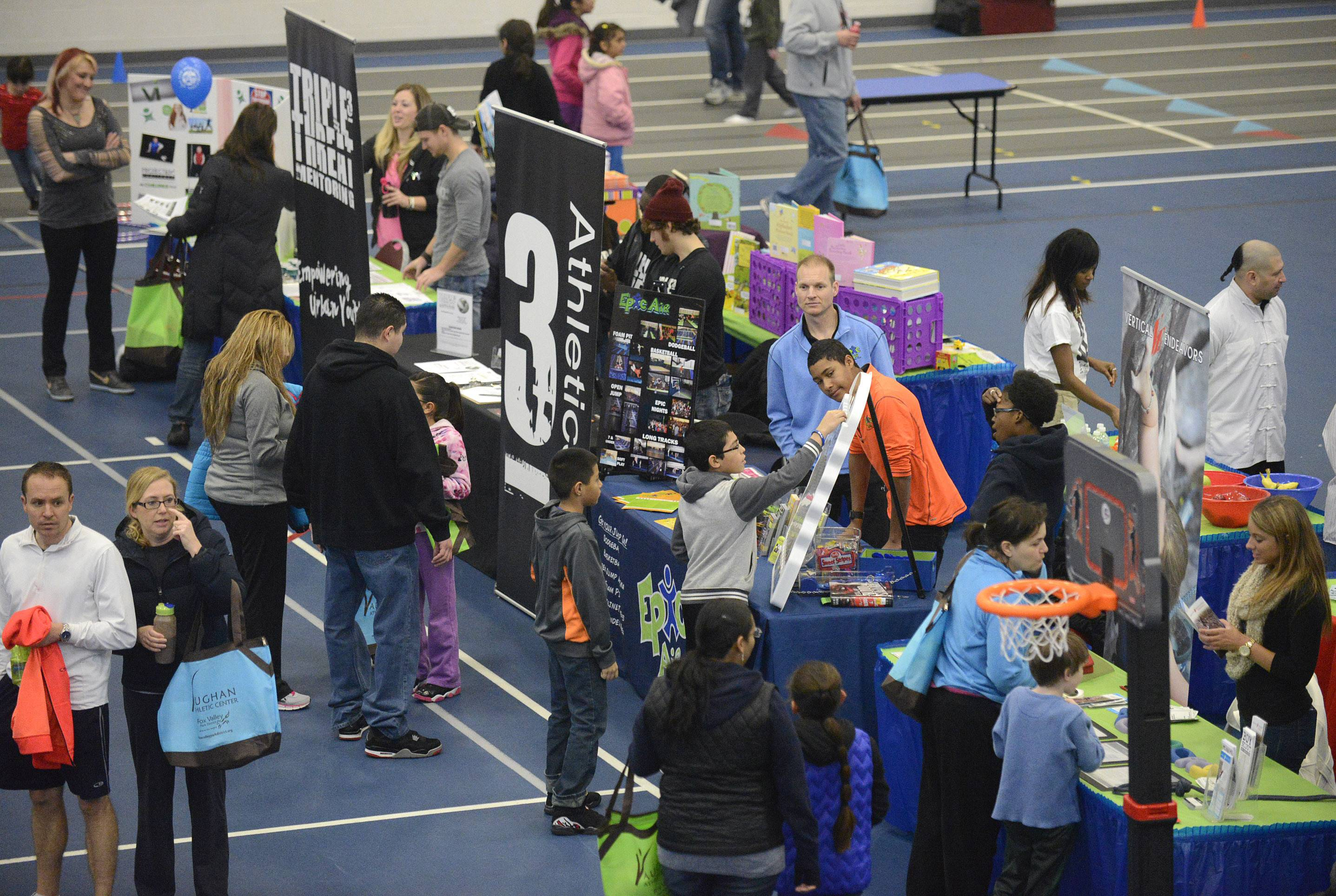 33 vendor tables featuring local businesses in the health, wellness and fitness industries drew families to their tables Saturday with interactive games or free goodies at the annual Fitness Fun Fair for Kids at the Vaughn Athletic Center in Aurora.