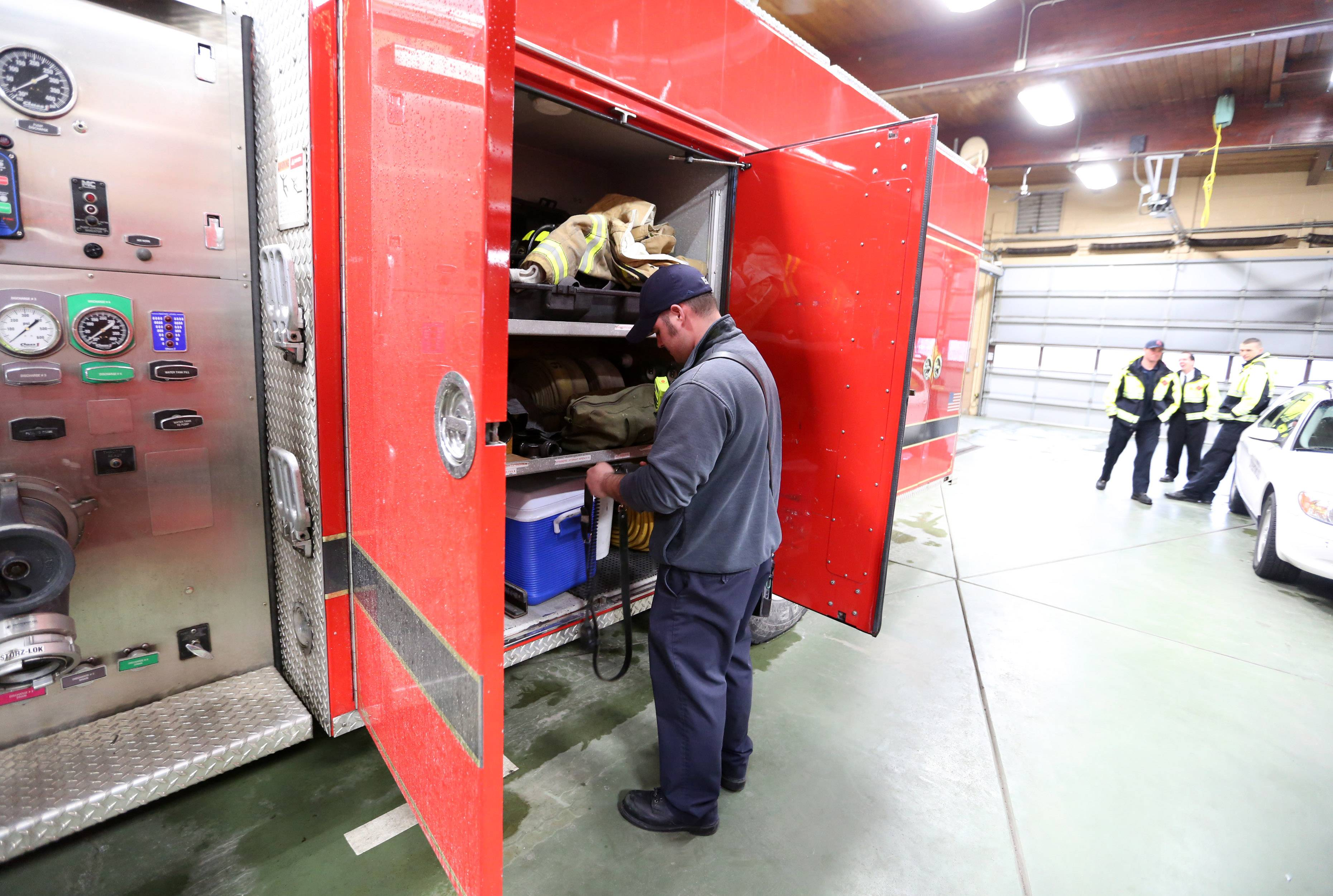 Streamwood firefighter-paramedic Joe Enzbigilis inspects equipment on a truck at Streamwood Fire Station No. 1 on Park Boulevard.