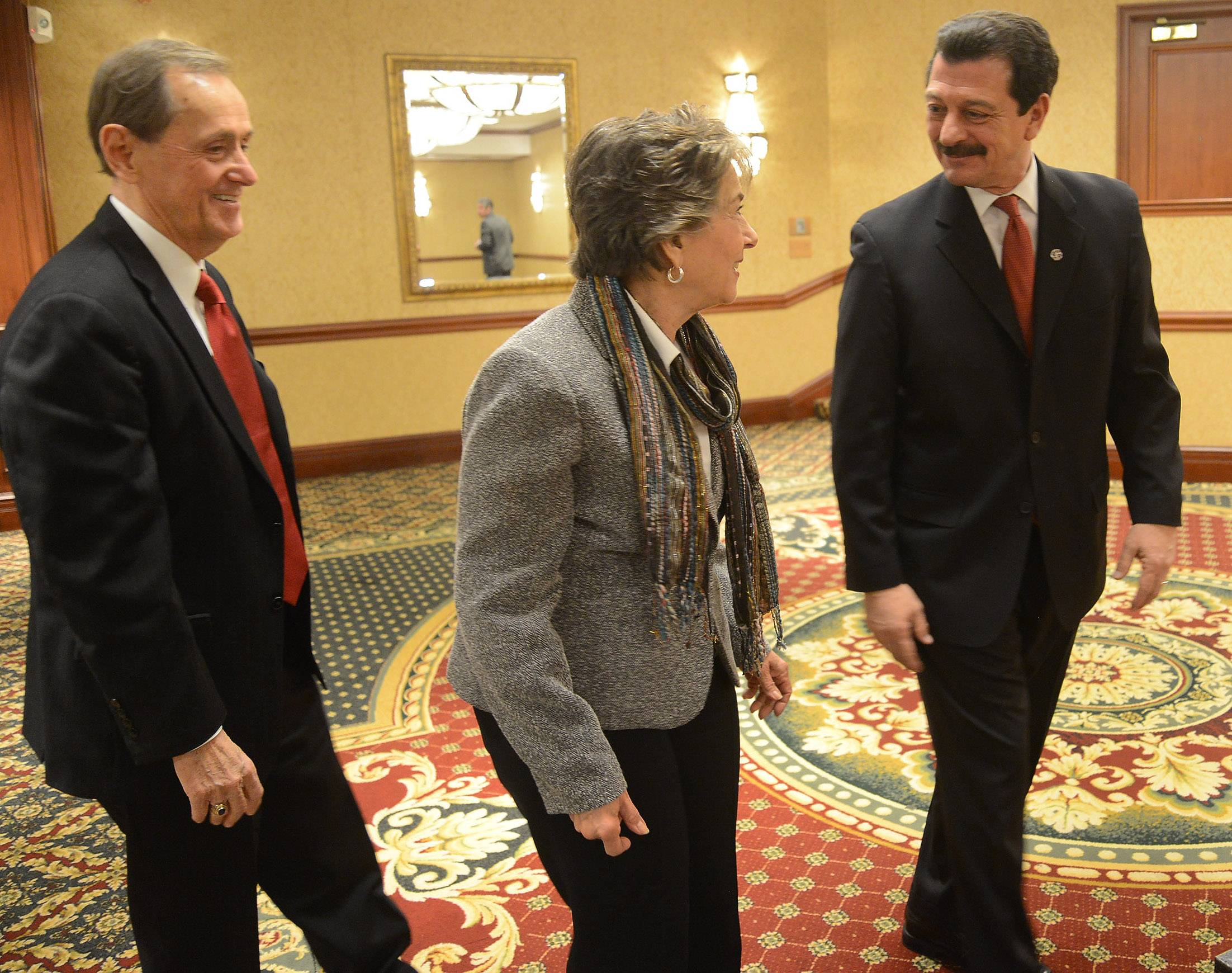 Prospect Heights Mayor Nick Helmer, left, and Wheeling Village President Dean Argiris, talk with U.S. Rep. Jan Schakowsky, an Evanston Democrat, at Friday at the state of the municipalities lunch.