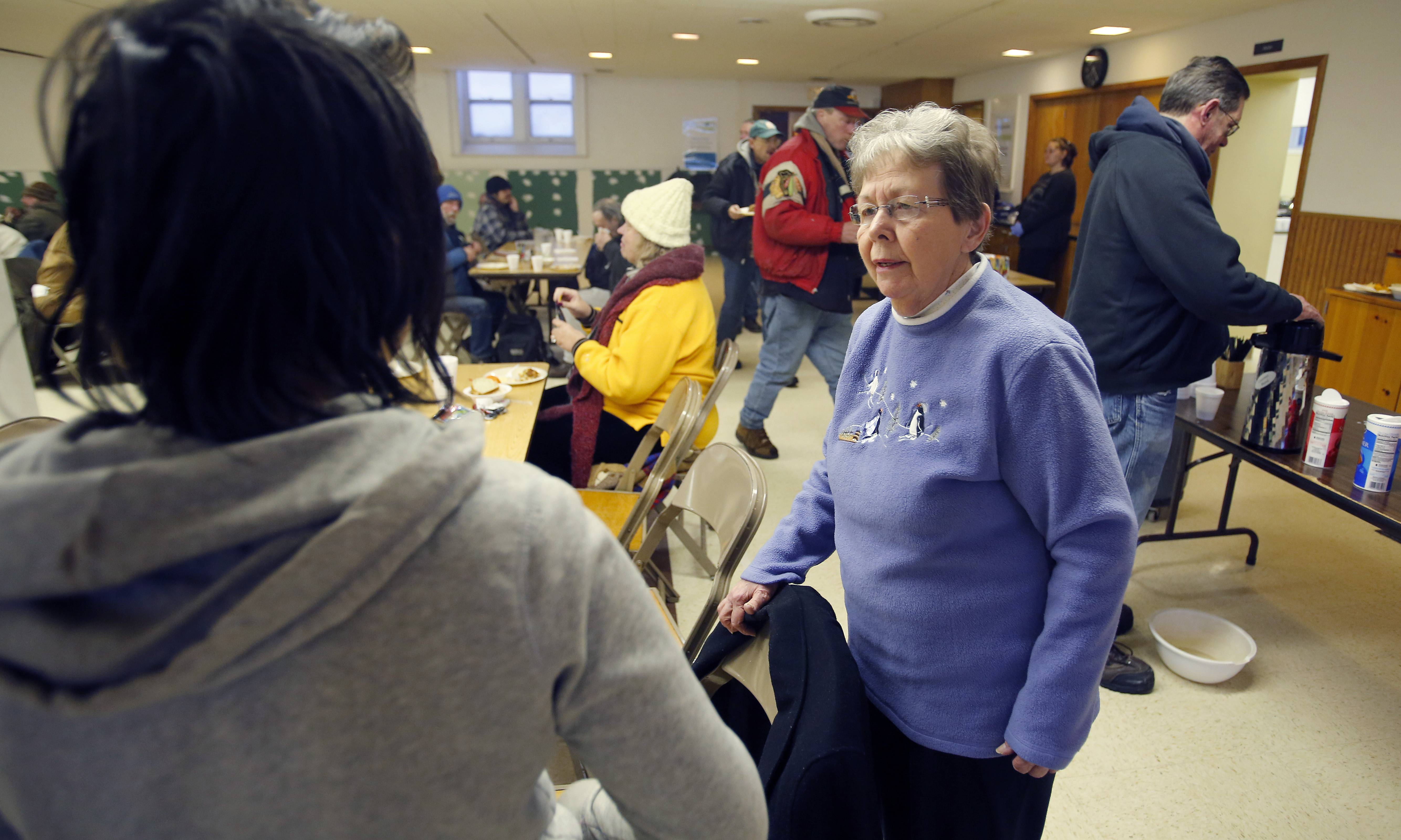 "Nancy Merlak organizes the community breakfast ministry at Vineyard Church of Elgin. ""(The guests) are here for the food and a warm place,"" Merlak said. ""And that's OK."""