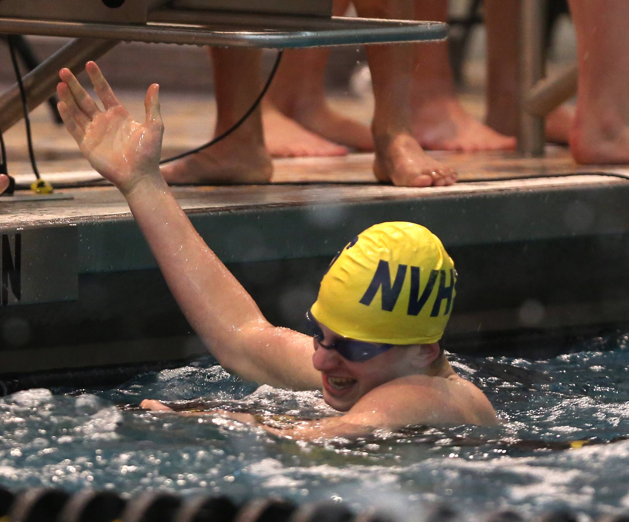 Neuqua Valley's Joe Widuch celebrates a first place finish after anchoring a 400 yard freestyle relay win during the Metea Valley boys swimming sectional.