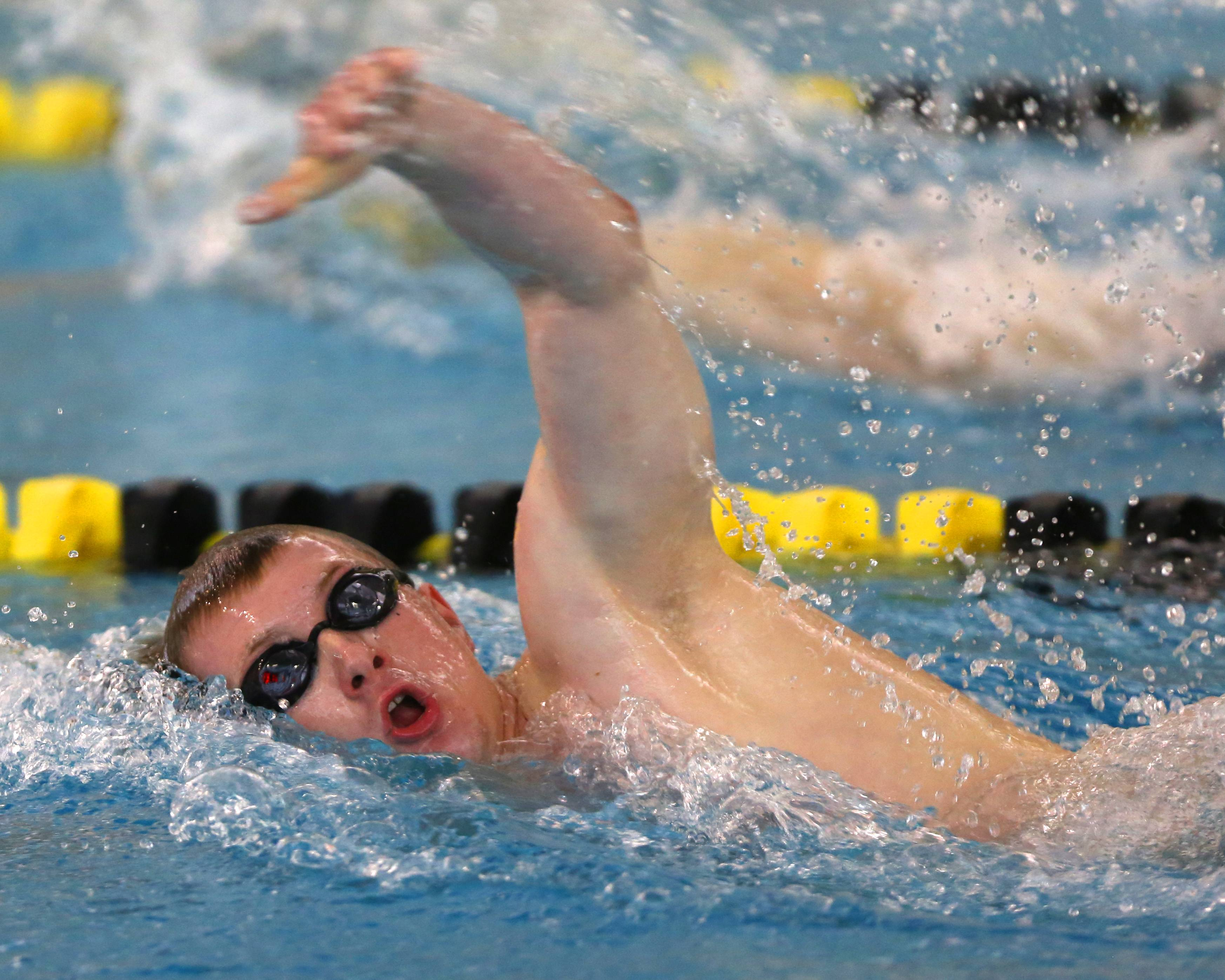 Naperville Central's Connor Lamb swims the 500 yard freestyle during the Metea Valley boys swimming sectional.