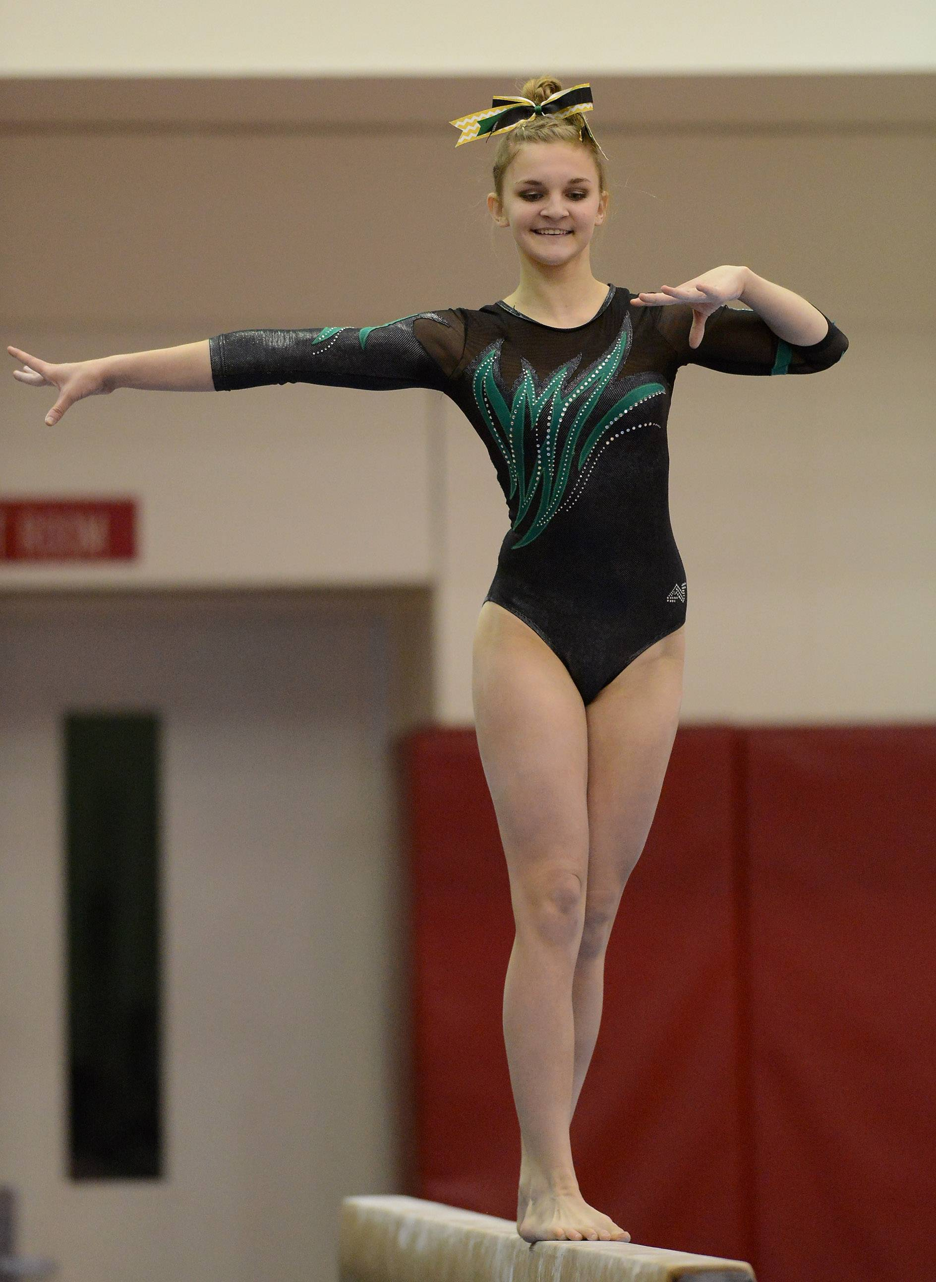 Sydney Plichta of Fremd finishes sixth on the balance beam during the girls gymnastics state finals at Palatine on Saturday.