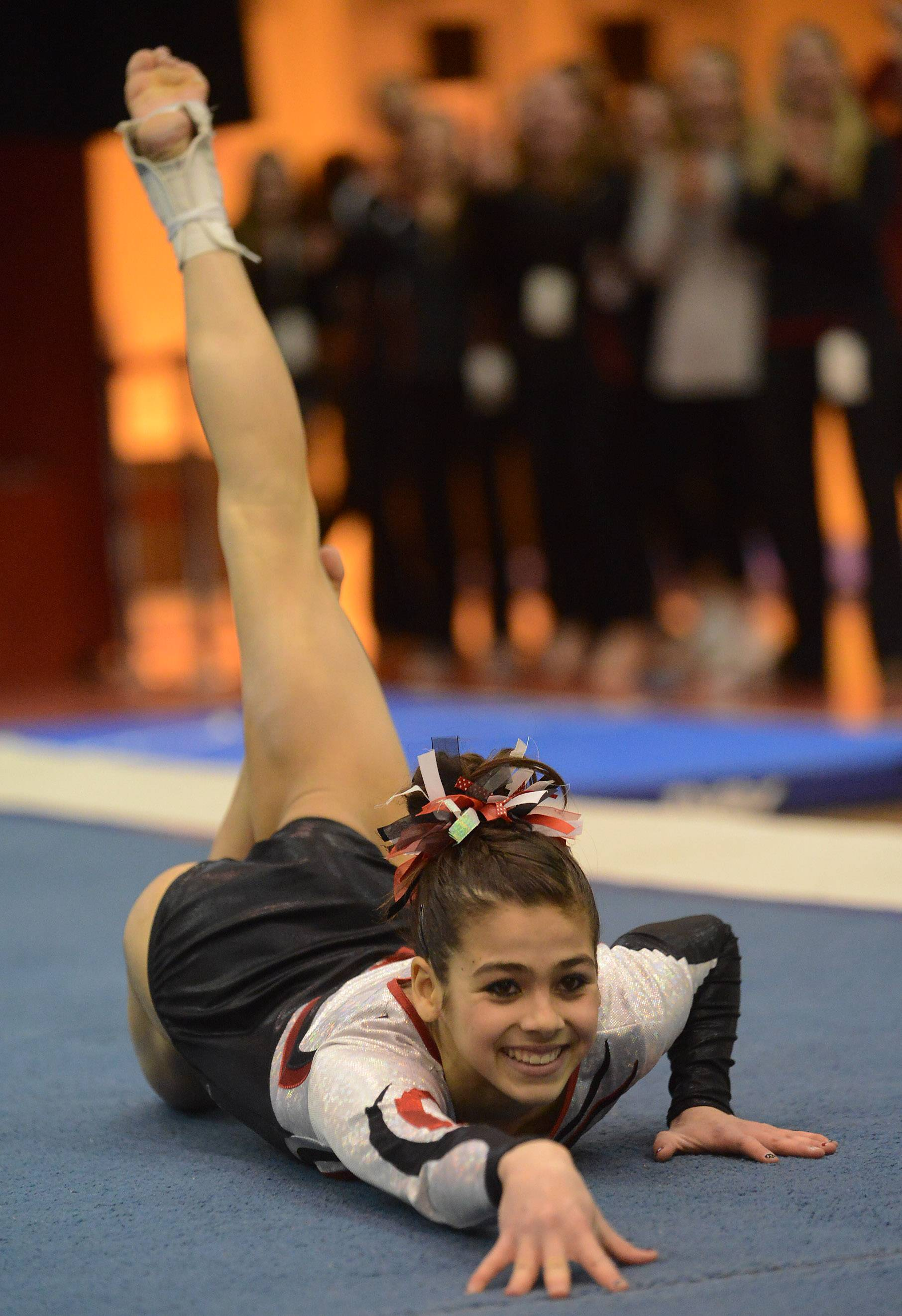 Abby Hasanov of Barrington on floor exercise during the girls gymnastics state finals at Palatine on Saturday.