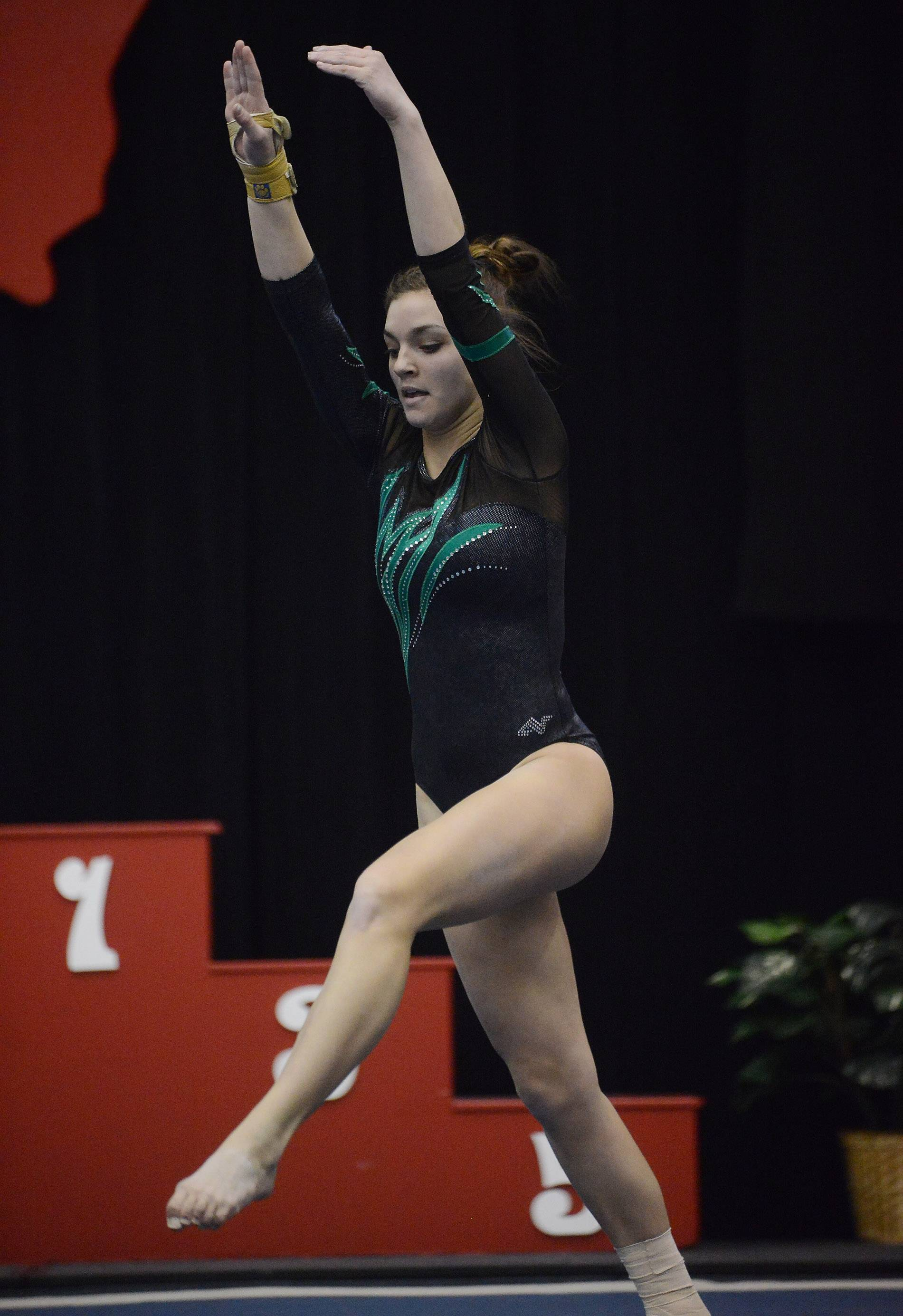 Bob Chwedyk/bchwedyk@dailyherald.comChristine Radochonski of Fremd on floor exercise during the girls gymnastics state final at Palatine on Saturday.
