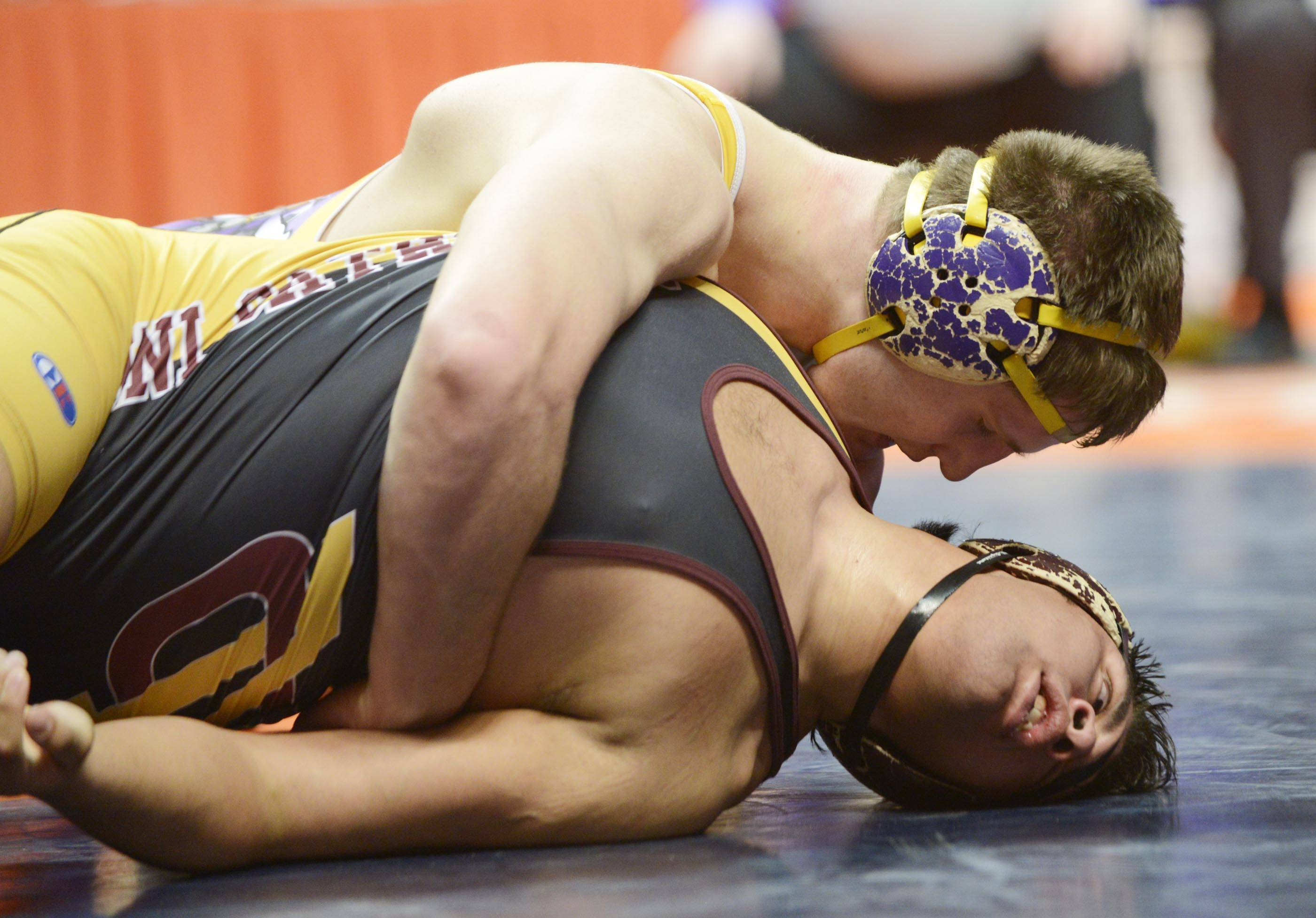 Nate Magiera of Wauconga High School holds down Edgar Ruano Montini in the Class 2A 220-pound championship match in Champaign on Saturday. Magiera won the title with a 17-4 decision.