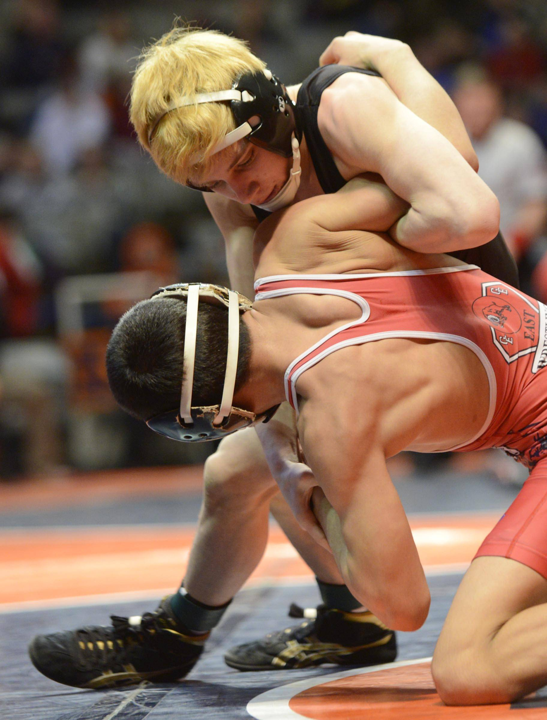 Kirk Johansen of Glenbard North High School competes against Carlos Fuentez of Glenbard East High School Saturday in the 106-pound weight class third place match of the wrestling IHSA Class 3A state tournament at State Farm Center in Champaign.