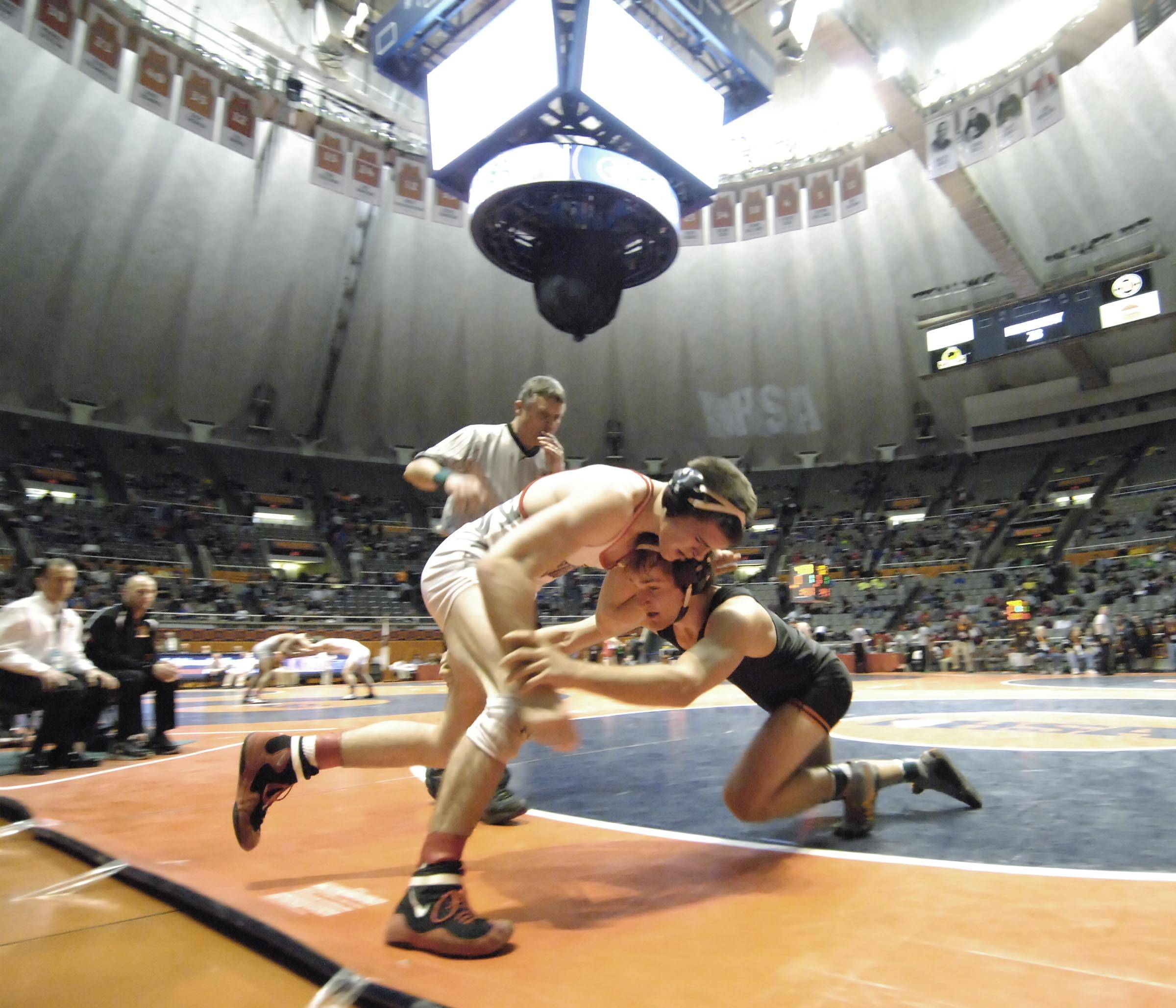 Kayne MacCallum of Libertyville High School competes against Bryce Gorman of Lincolnway Central High School Saturday in the 170-pound weight class third place match of the wrestling IHSA Class 3A state tournament at State Farm Center in Champaign.