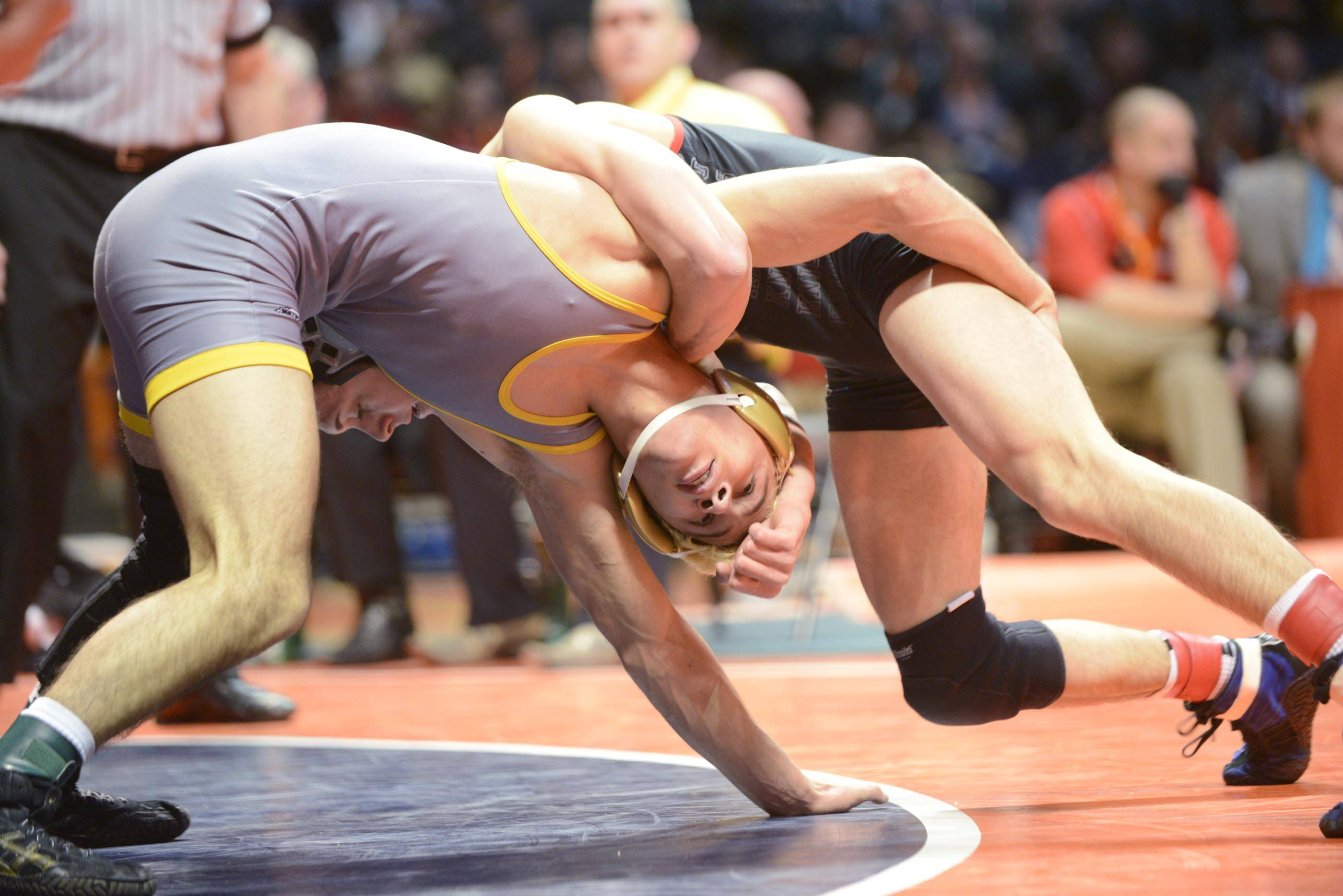 Jared Cortez of Glenbard North High School competes against Joey Nelson of Lincoln-Way Central High School Saturday in the 132-pound weight class championship match of the wrestling IHSA Class 3A state tournament at State Farm Center in Champaign.
