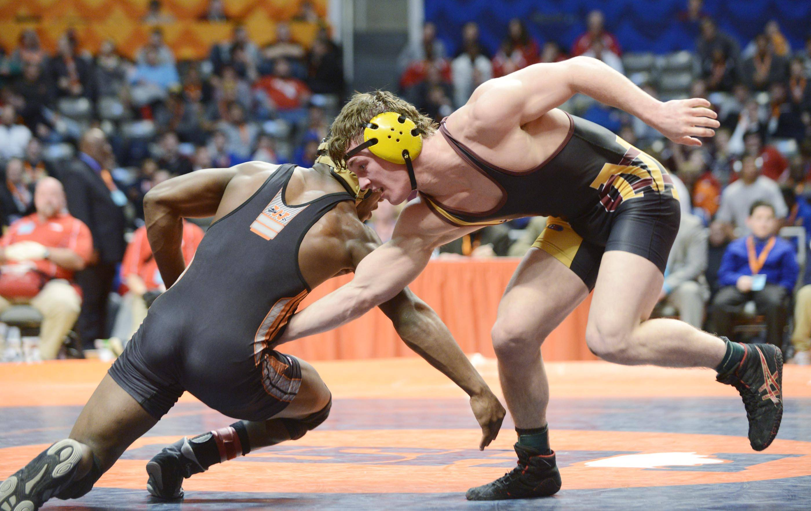 Luke Fortuna of Lombard Montini Catholic High School competes against Randy Meneweather of Washington High School Saturday in the 152-pound weight class championship match of the wrestling IHSA Class 2A state tournament at State Farm Center in Champaign.