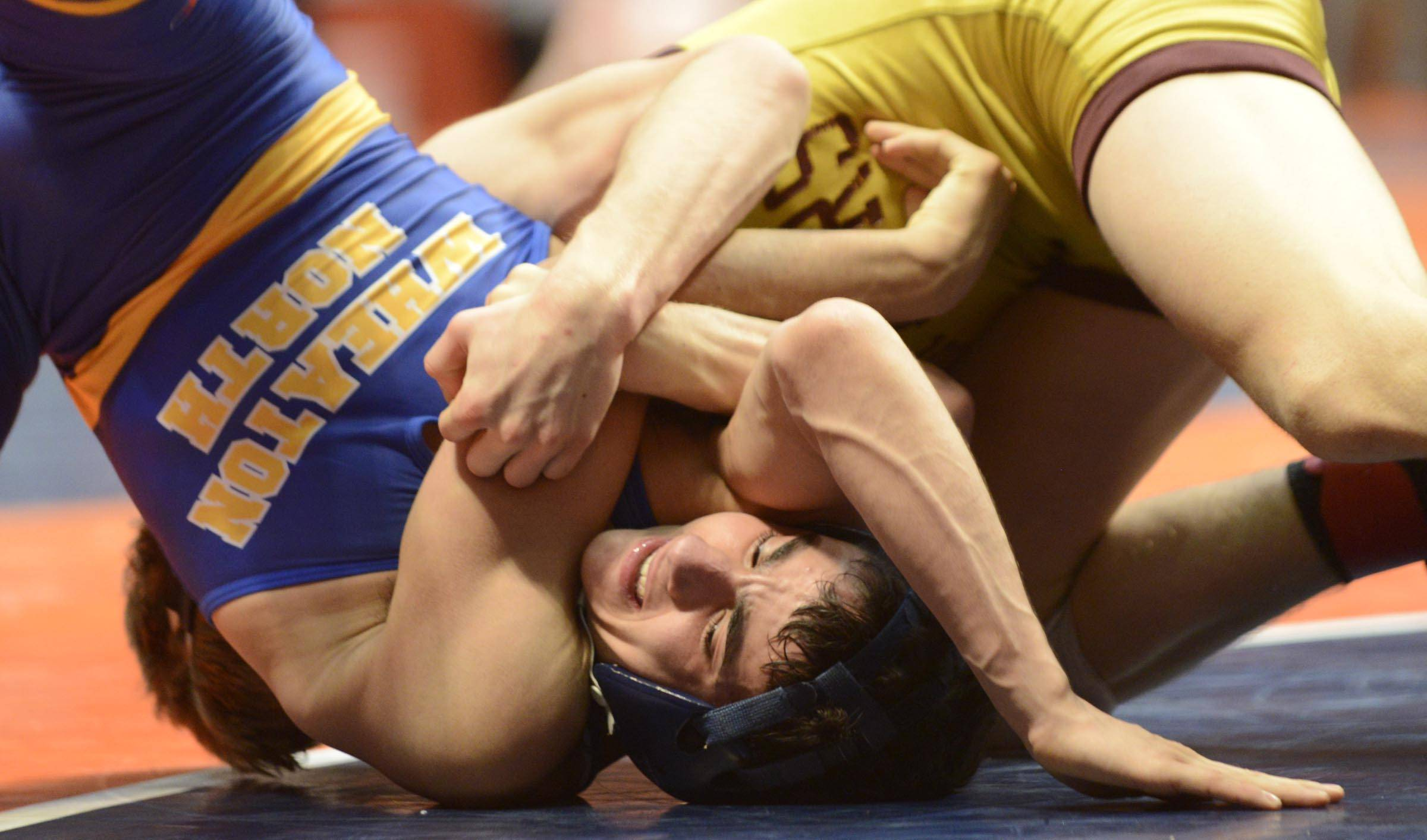 Dylan Thurston of Wheaton North High School competes against Shayne Oster of Lockport High School Saturday in the 126-pound weight class third place match of the wrestling IHSA Class 3A state tournament at State Farm Center in Champaign.