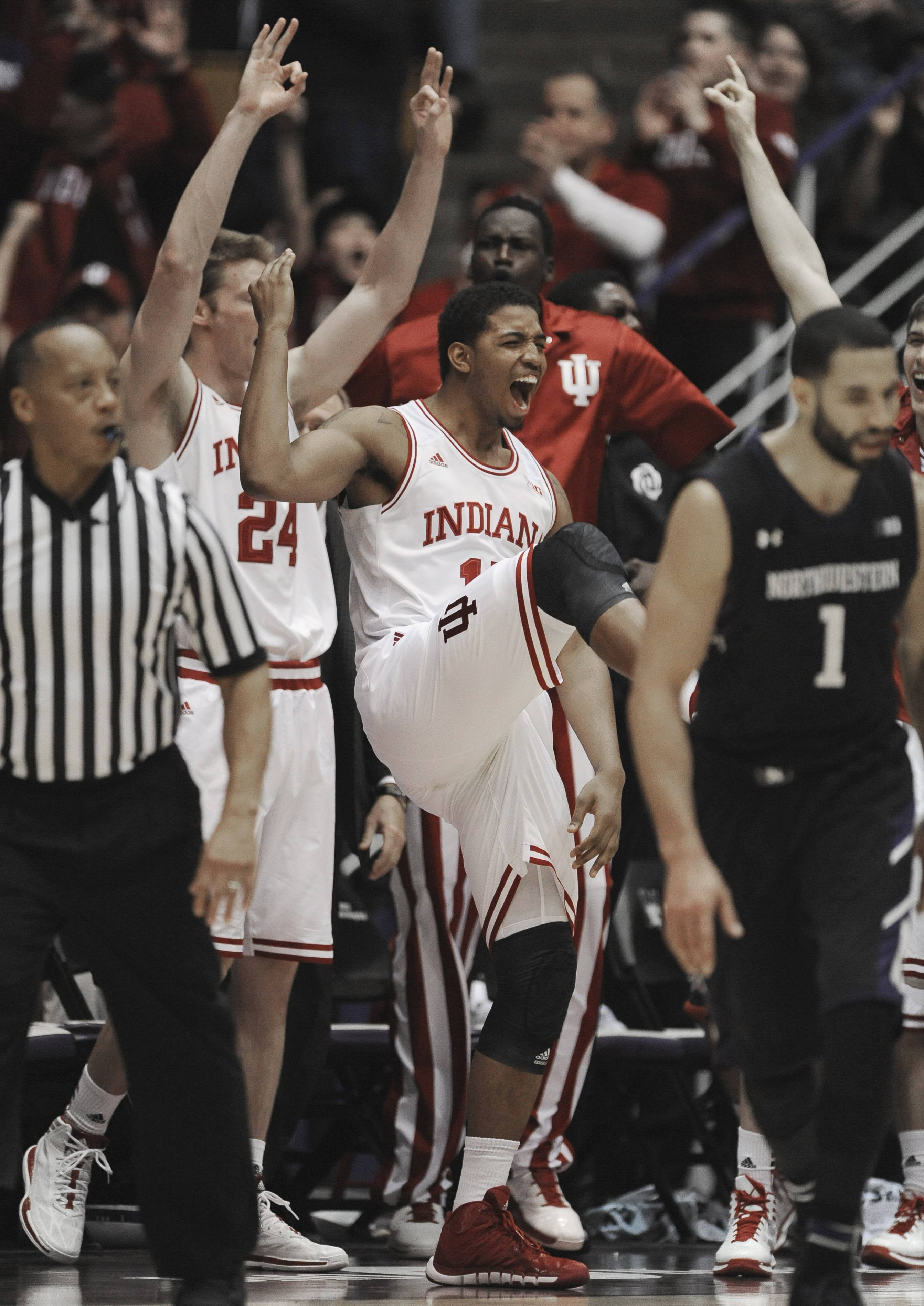 Indiana's Devin Davis (15) and the rest of the bench celebrate during the final seconds.