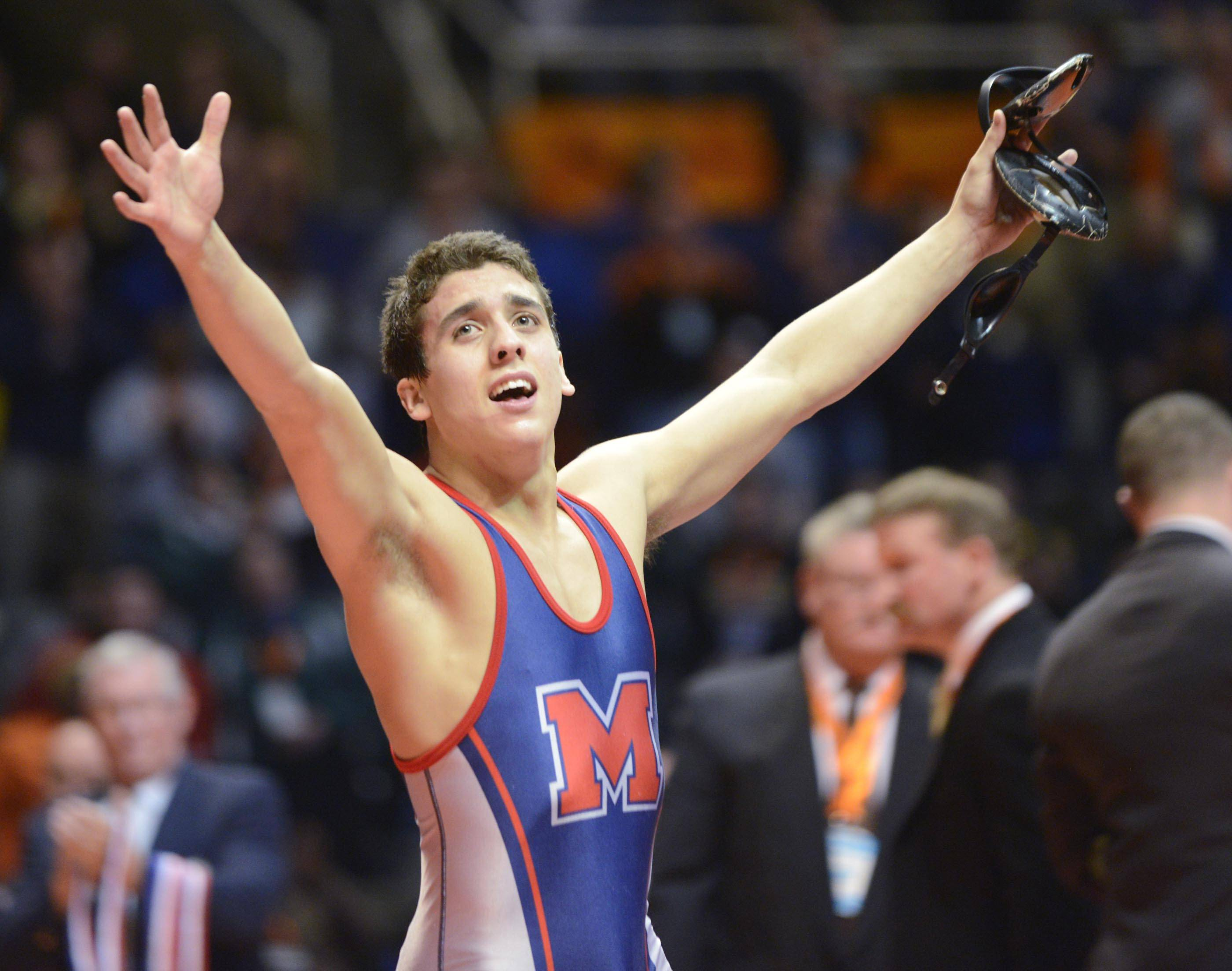 Johnny Jimeniz of Marmion celebrates his fourth state championship after beating Jon Marmolejo of Glenbard North Saturday at 126 pounds in Champaign.
