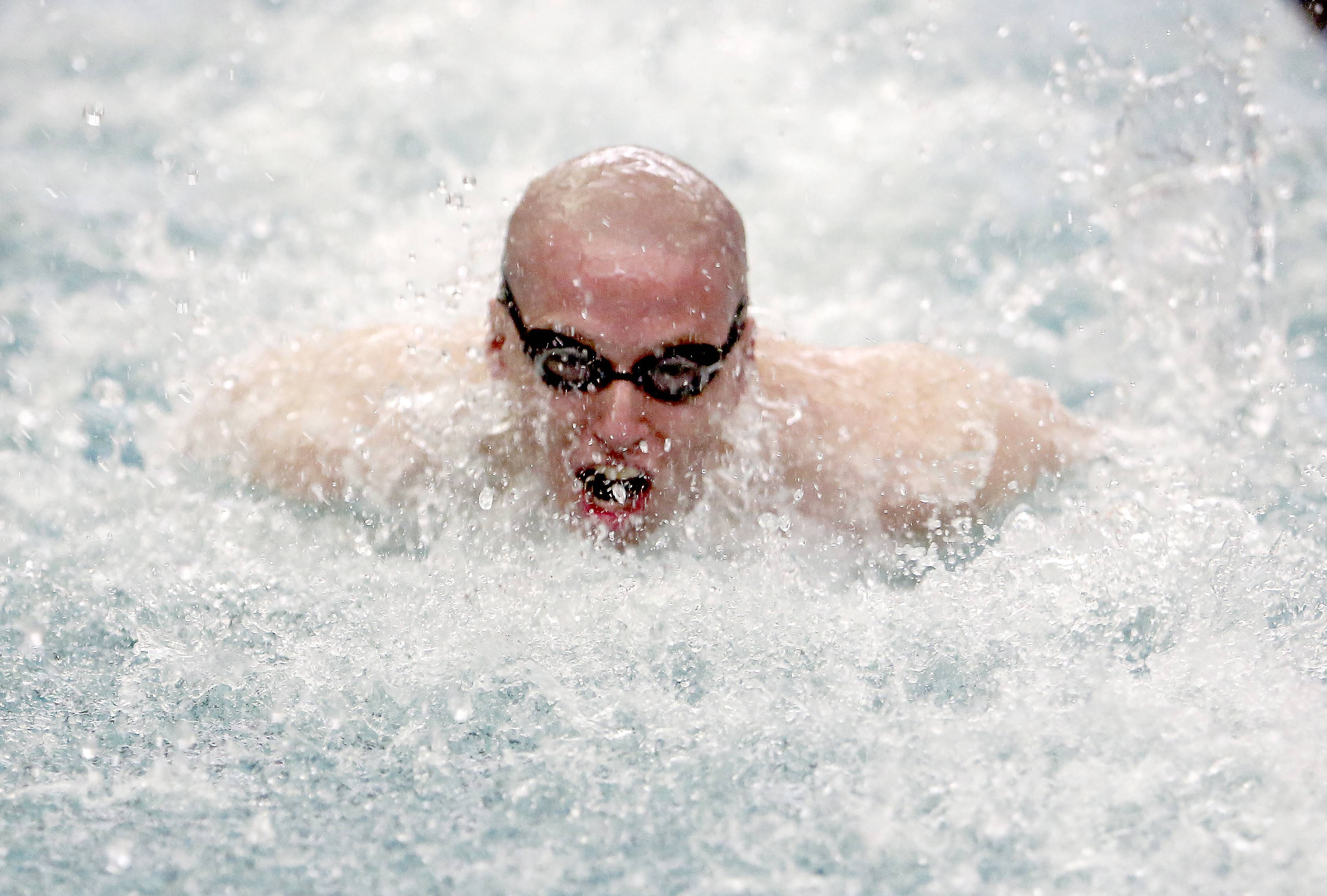 St. Charles North's Timothy Steele, competes in the 200 yard medley relay during the 2014 Boys Swimming and Diving IHSA Sectional Championships Saturday at St. Charles North High School in St. Charles.