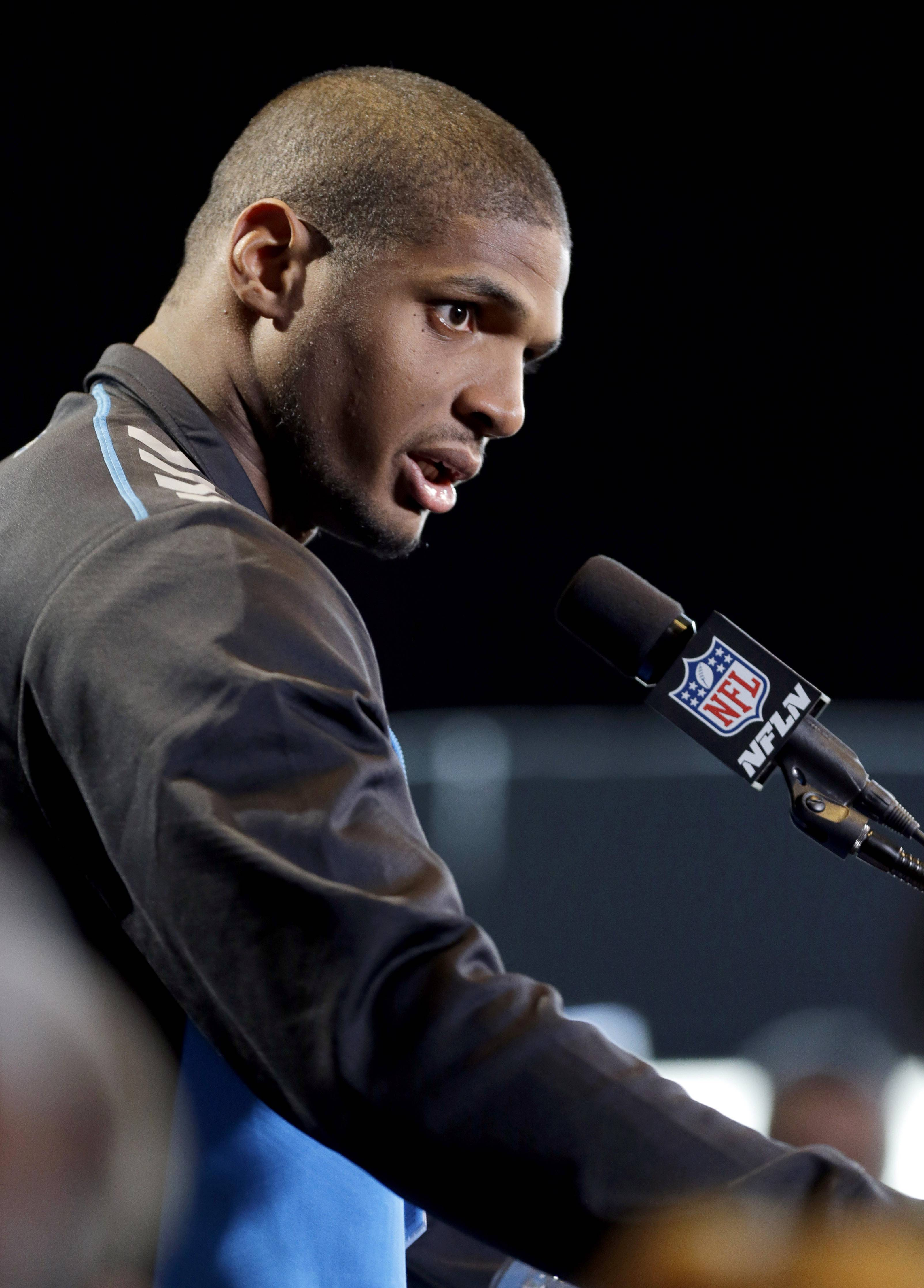 Missouri defensive end Michael Sam speaks during a news conference at the NFL football scouting combine in Indianapolis, Saturday, Feb. 22, 2014.