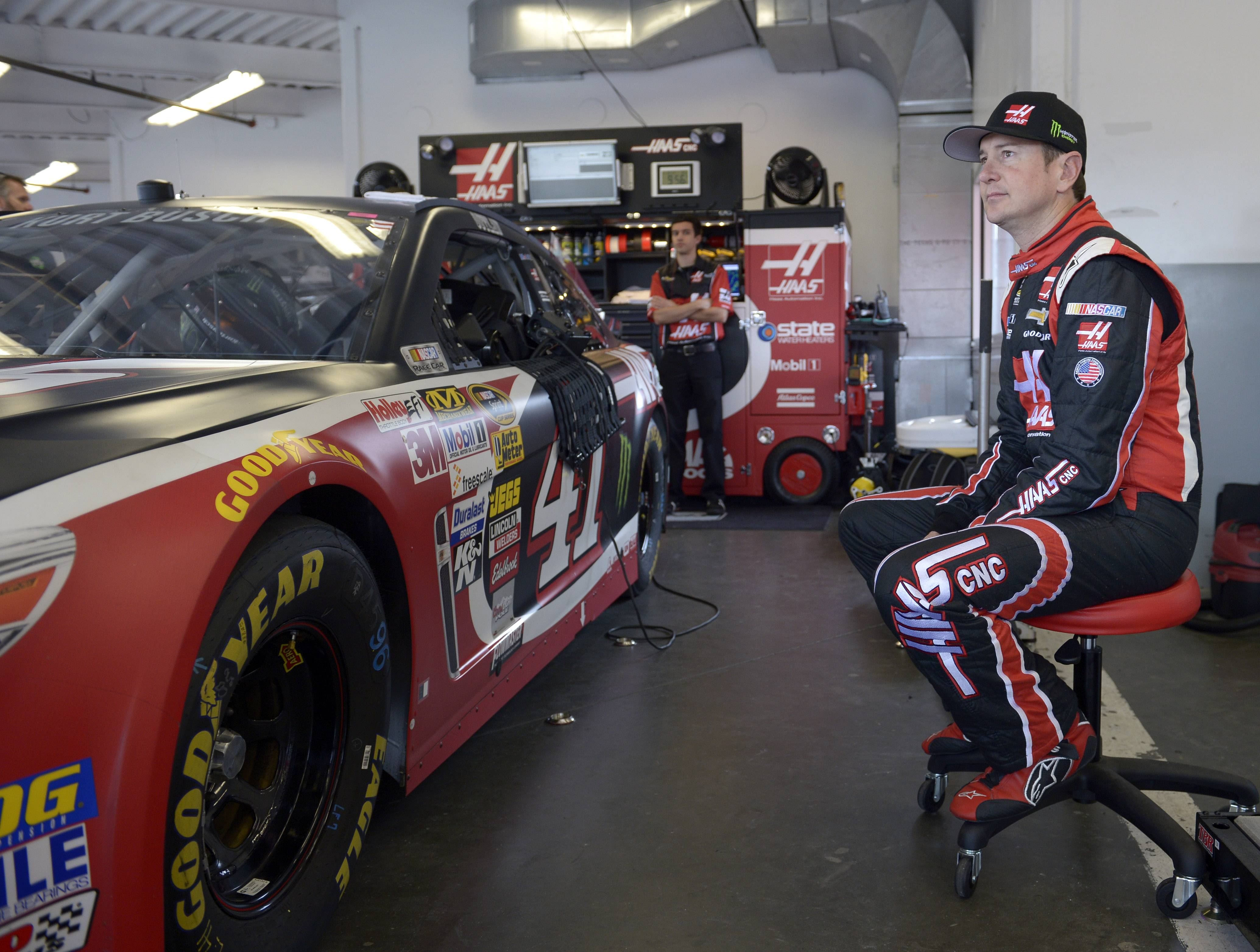 Kurt Busch sits by his car before practice for Sunday's NASCAR Daytona 500 Sprint Cup series auto race at Daytona International Speedway in Daytona Beach, Fla., Saturday.