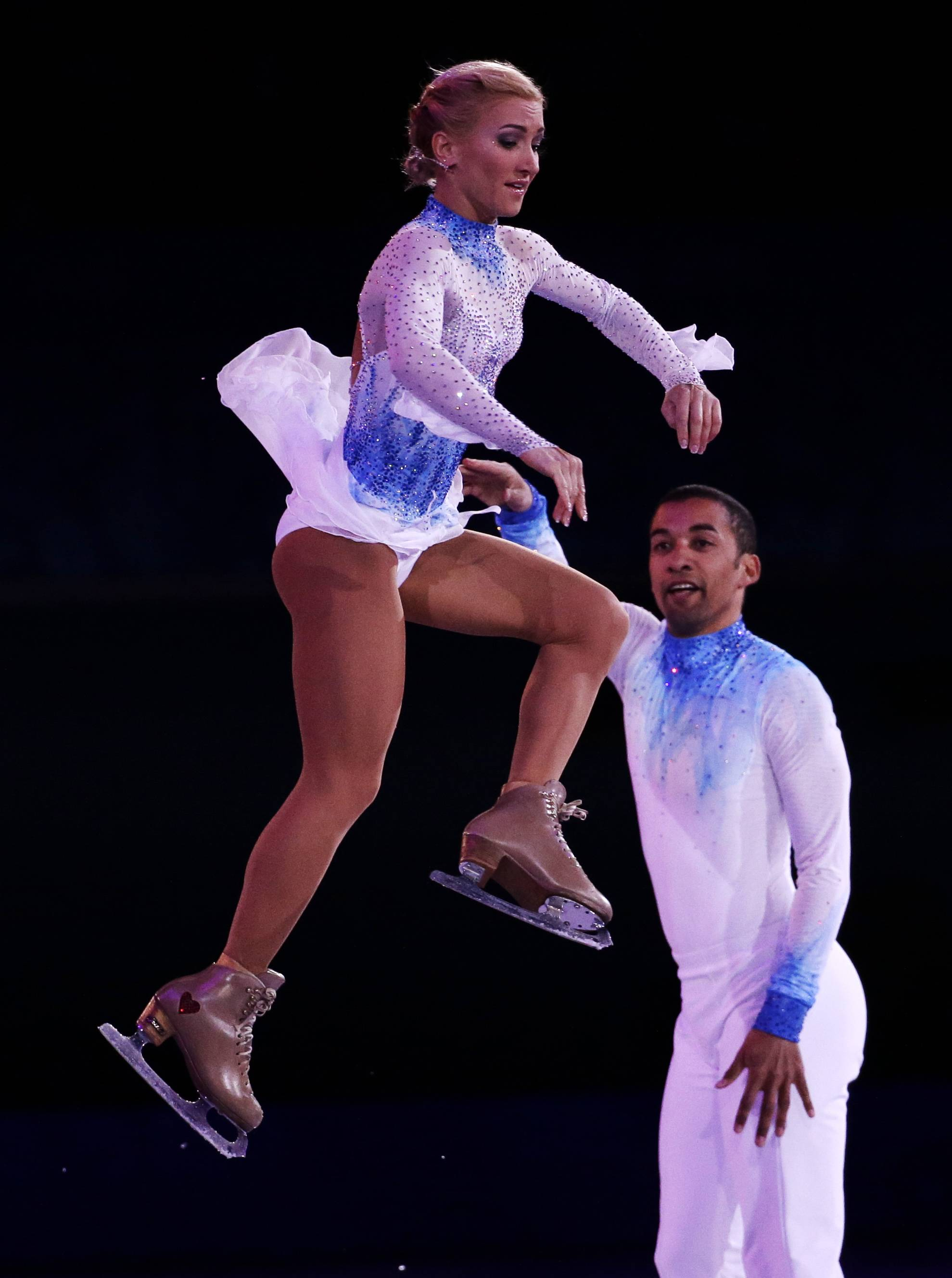 Aliona Savchenko and Robin Szolkowy of Germany perform during the figure skating exhibition gala at the Iceberg Skating Palace during the 2014 Winter Olympics, Saturday, Feb. 22, 2014, in Sochi, Russia.