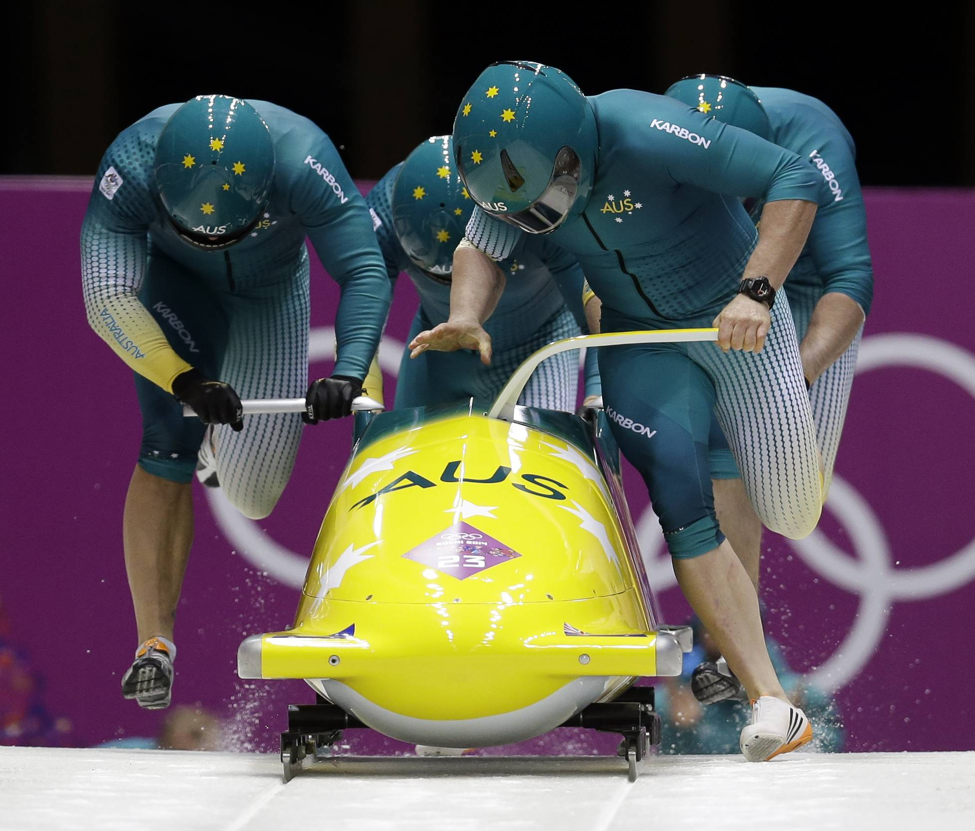 The team from Australia AUS-1, with Heath Spence, Gareth Nichols, Duncan Harvey, and Lucas Mata, start their first run during the men's four-man bobsled competition at the 2014 Winter Olympics, Saturday, Feb. 22, 2014, in Krasnaya Polyana, Russia.