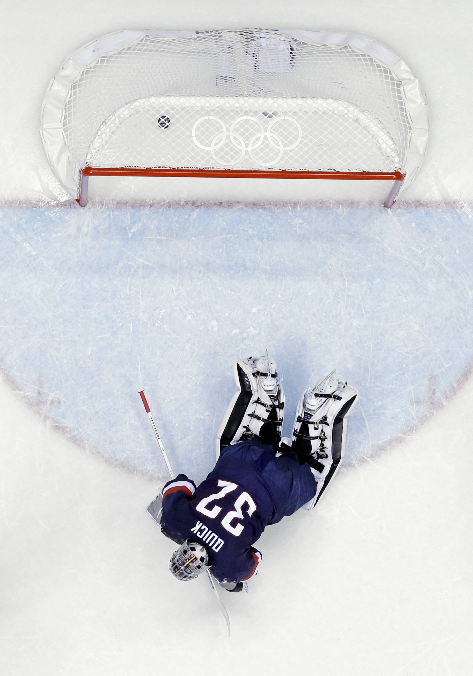 USA goaltender Jonathan Quick lays on the ice after giving up a goal during the third period of the men's bronze medal ice hockey game against Finland at the 2014 Winter Olympics, Saturday, Feb. 22, 2014, in Sochi, Russia.