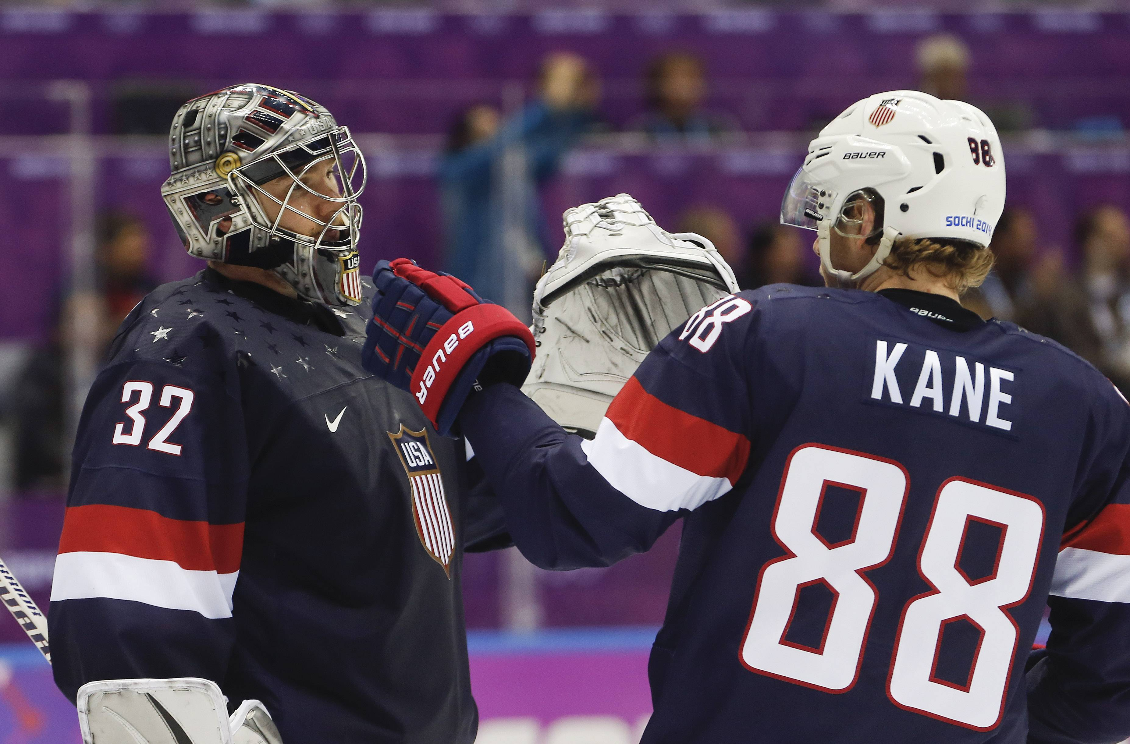 Blackhawk Patrick Kane, right, greets USA goaltender Jonathan Quick after Finland won 5-0 in the men's bronze medal ice hockey game Saturday.