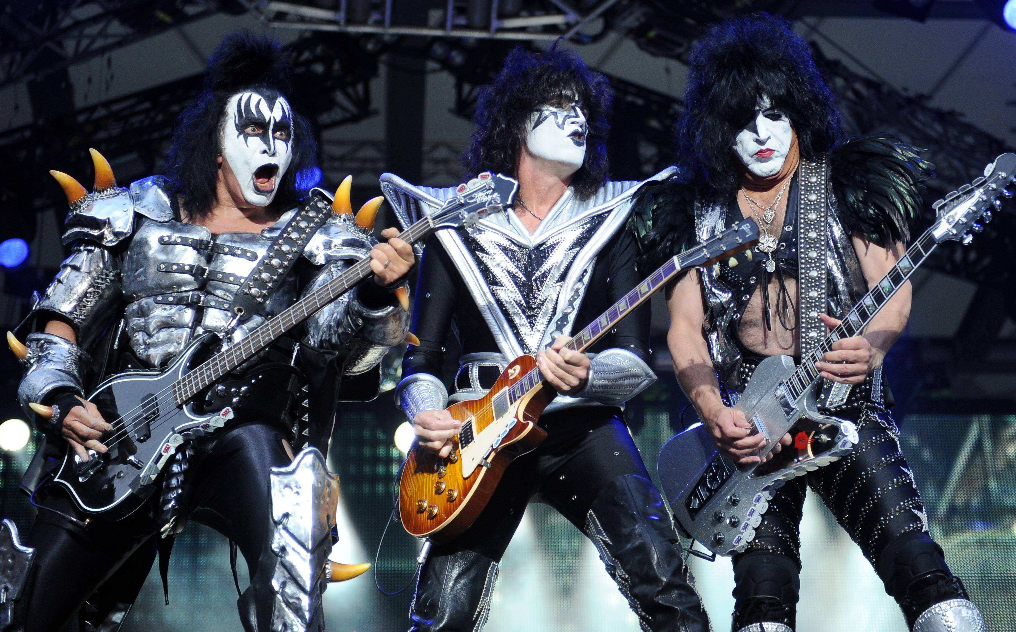 From left: KISS bassist Gene Simmons, guitarist Tommy Thayer and singer Paul Stanley of Kiss perform onstage in 2013 in Berlin, Germany. KISS announced Sunday that the band will not perform when they are inducted into the Rock and Roll Hall of Fame in Cleveland in April. The 40-year-old band is unable to agree on which lineup should perform during the April 10 ceremony in New York City.