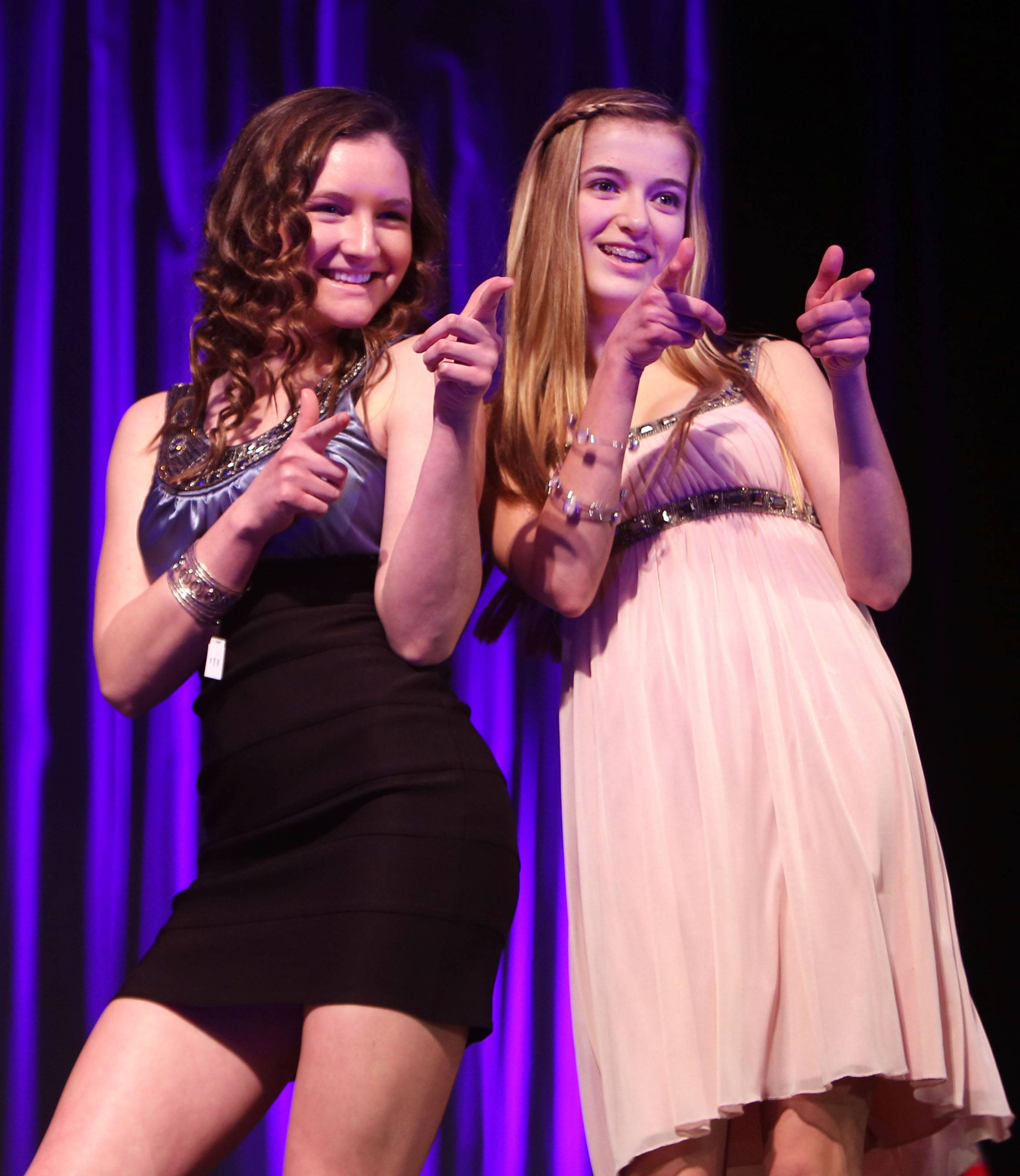 Rosary High School senior Monica Powers, left, and sophomore Shea Vero model dresses during the 4th annual Rosary National Honor Society dress sale and fashion show Sunday in Aurora. The event raises money for scholarships given to incoming freshmen.