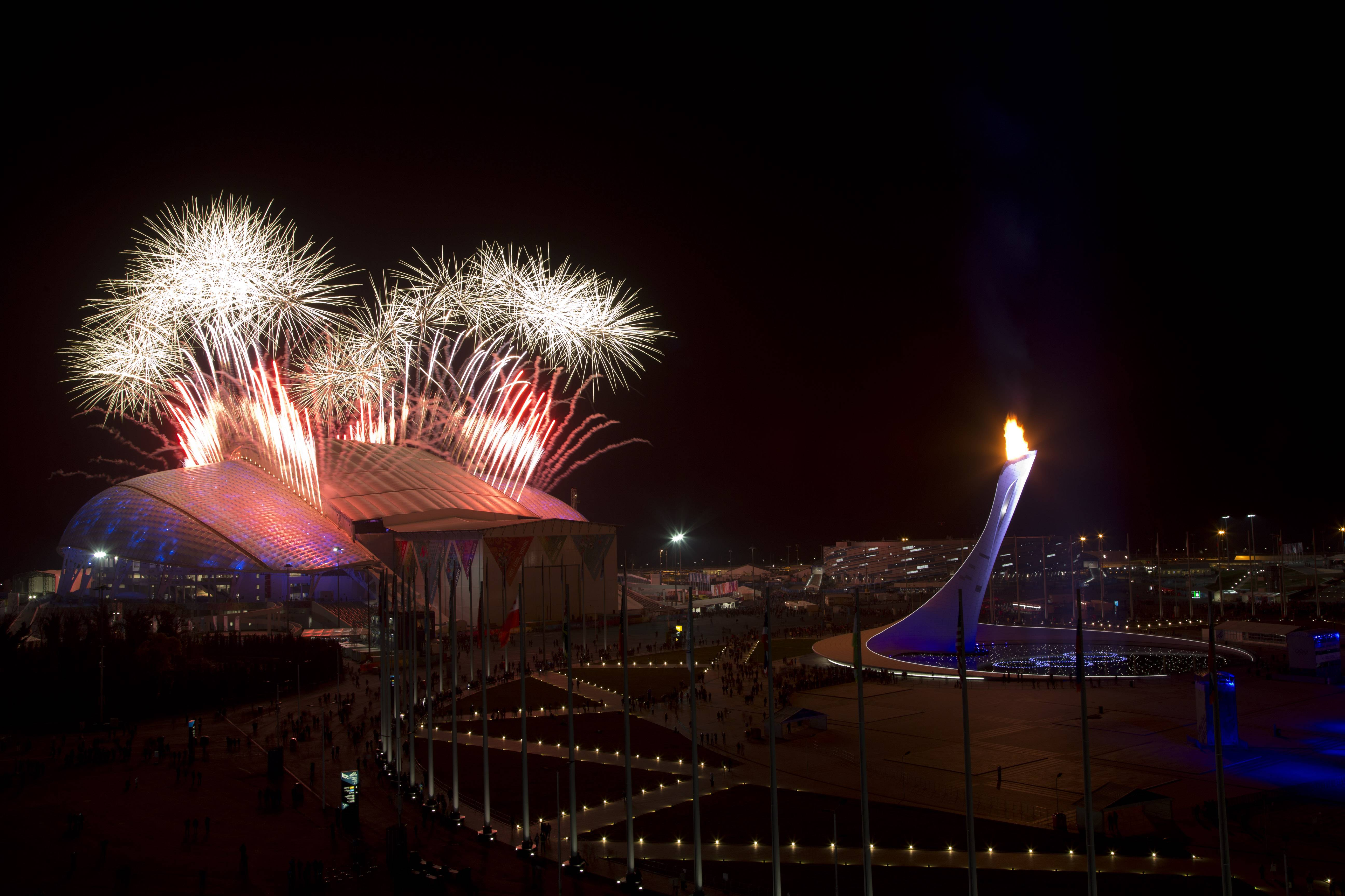 Fireworks explode seen over Olympic Park during the closing ceremony of the 2014 Winter Olympics, Sunday, Feb. 23, 2014, in Sochi, Russia.