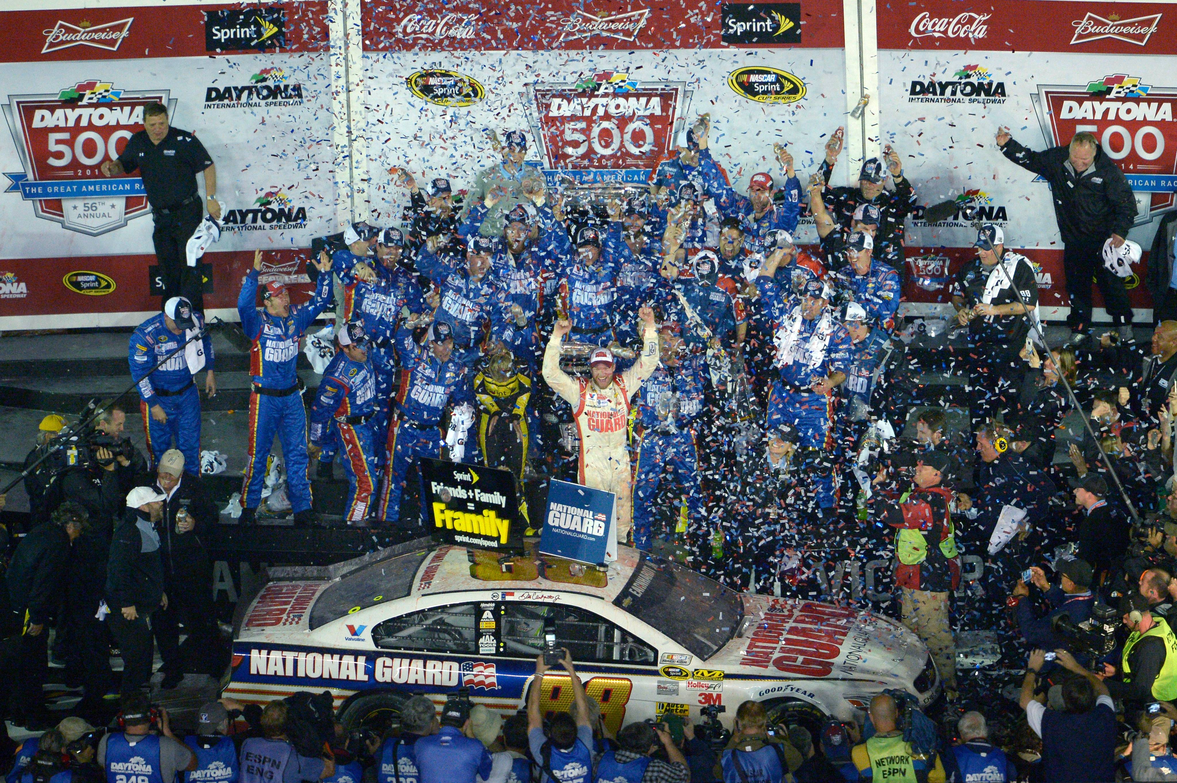 Dale Earnhardt Jr., center, celebrates with his team in Victory Lane after winning the NASCAR Daytona 500 auto race at Daytona International Speedway in Daytona Beach, Fla., Sunday, Feb. 23, 2014.