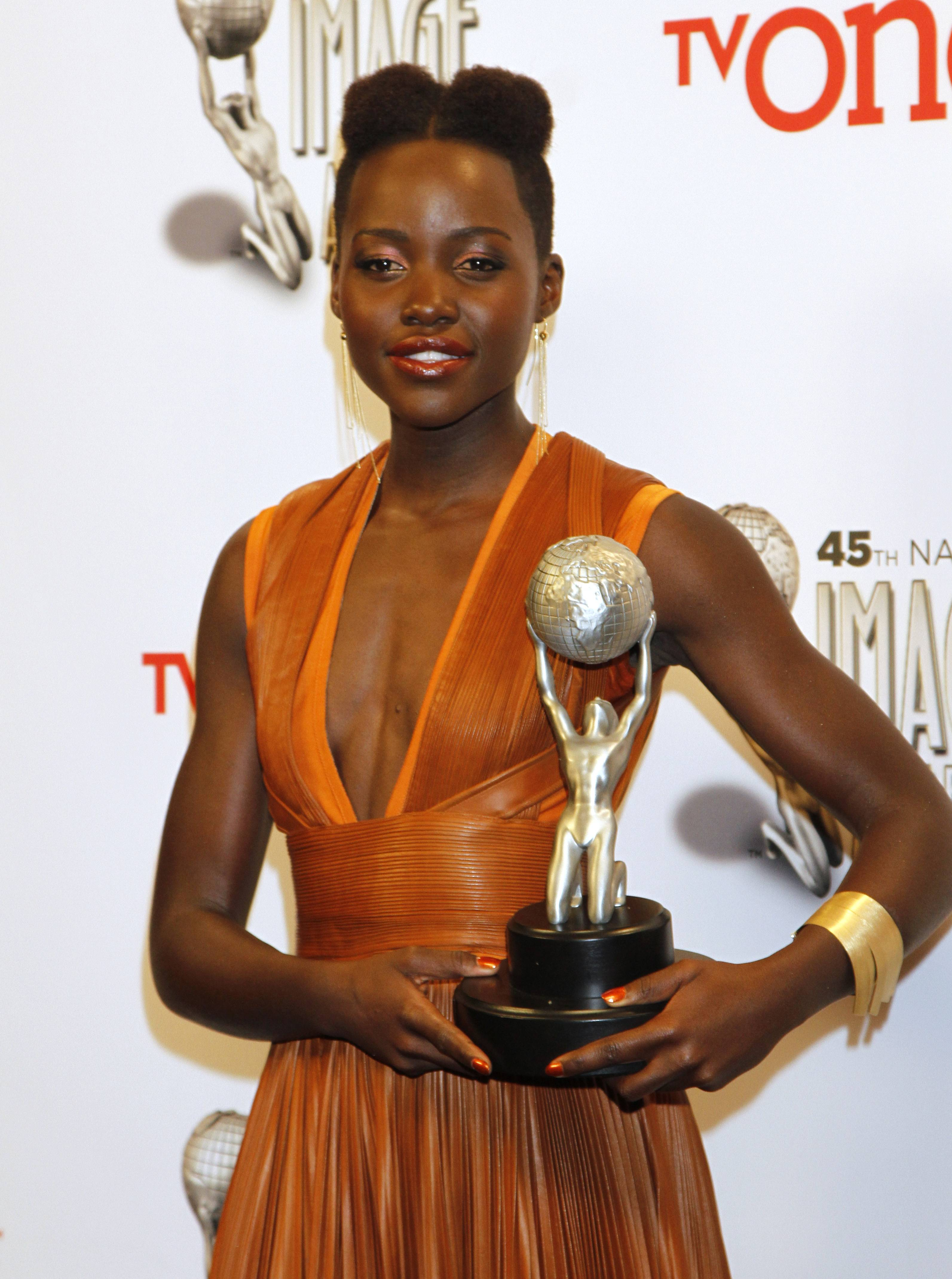 "Lupita Nyong'o poses in the press room with the award for outstanding supporting actress in a motion picture for ""12 Years a Slave"" at the 45th NAACP Image Awards at the Pasadena Civic Auditorium on Saturday in Pasadena, Calif."