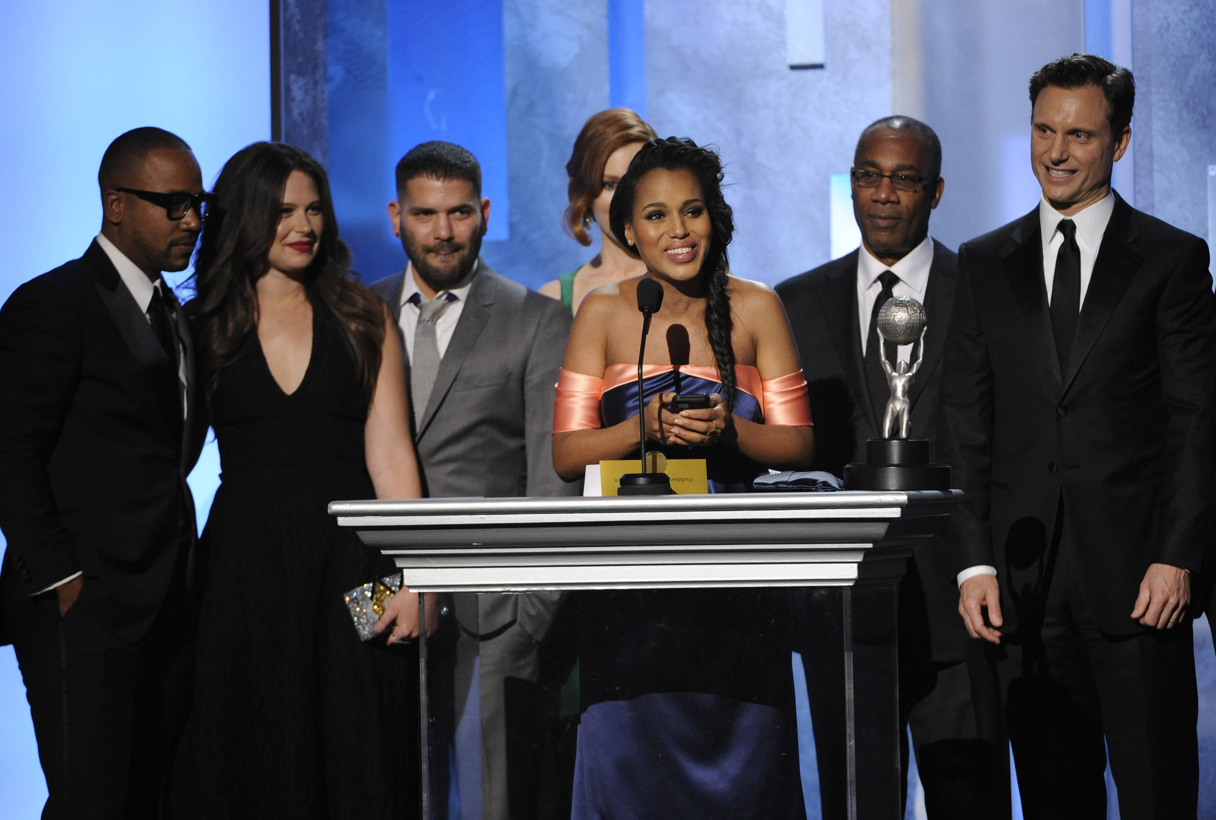"From left, Columbus Short, Katie Lowes, Guillermo Díaz, Darby Stanchfield, Kerry Washington, Joe Morton, and Tony Goldwyn accept the award for outstanding drama series for ""Scandal"" at the 45th NAACP Image Awards at the Pasadena Civic Auditorium on Saturday in Pasadena, Calif."