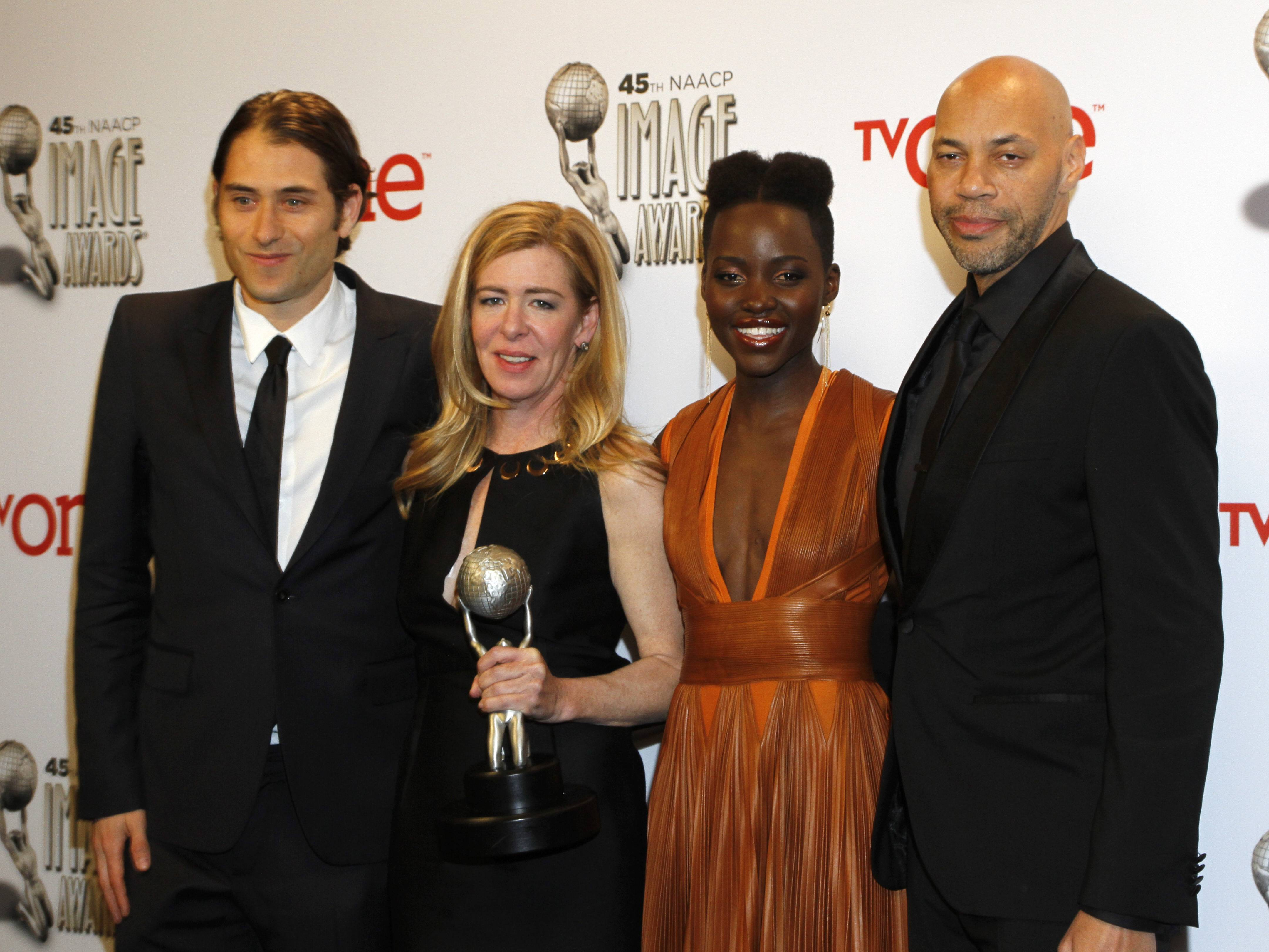"From left, Jeremy Kleiner, Dede Gardner, Lupita Nyong'o, and John Ridley pose in the press room with the award for outstanding motion picture for ""12 Years a Slave"" at the 45th NAACP Image Awards at the Pasadena Civic Auditorium on Saturday in Pasadena, Calif."