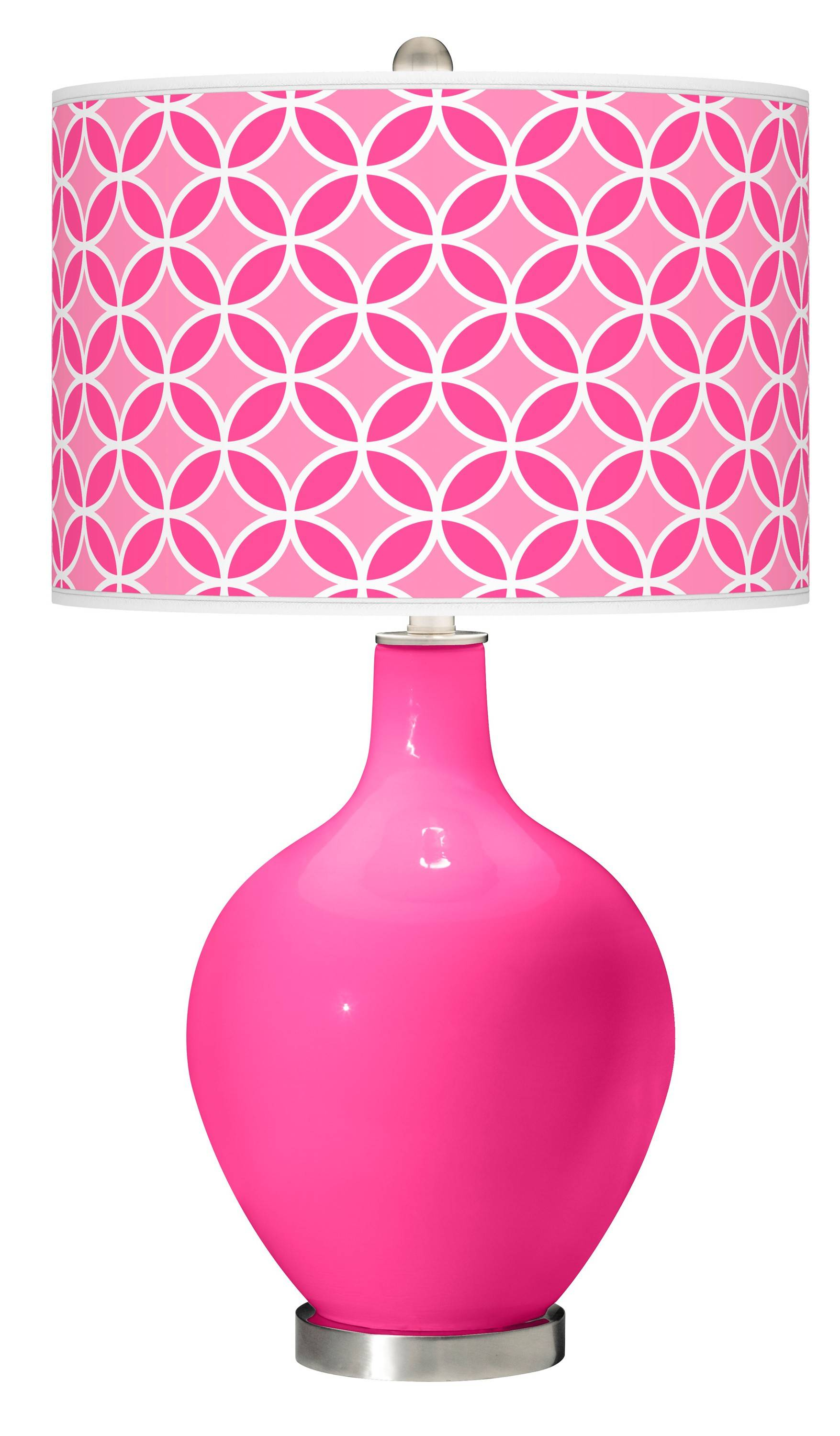 An Ovo table lamp in fuchsia glass brings a punch of pink into spring decor.