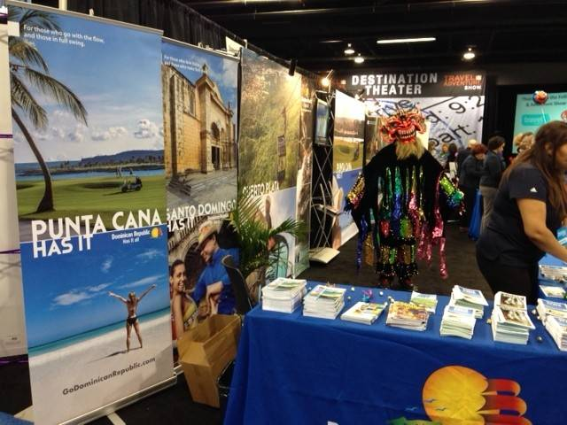 A masked dancer works the booth for Punta Cana, in the Dominican Republic, during the Travel & Adventure Show last month in Rosemont. Dominican Republic is one of the hot destinations this spring.