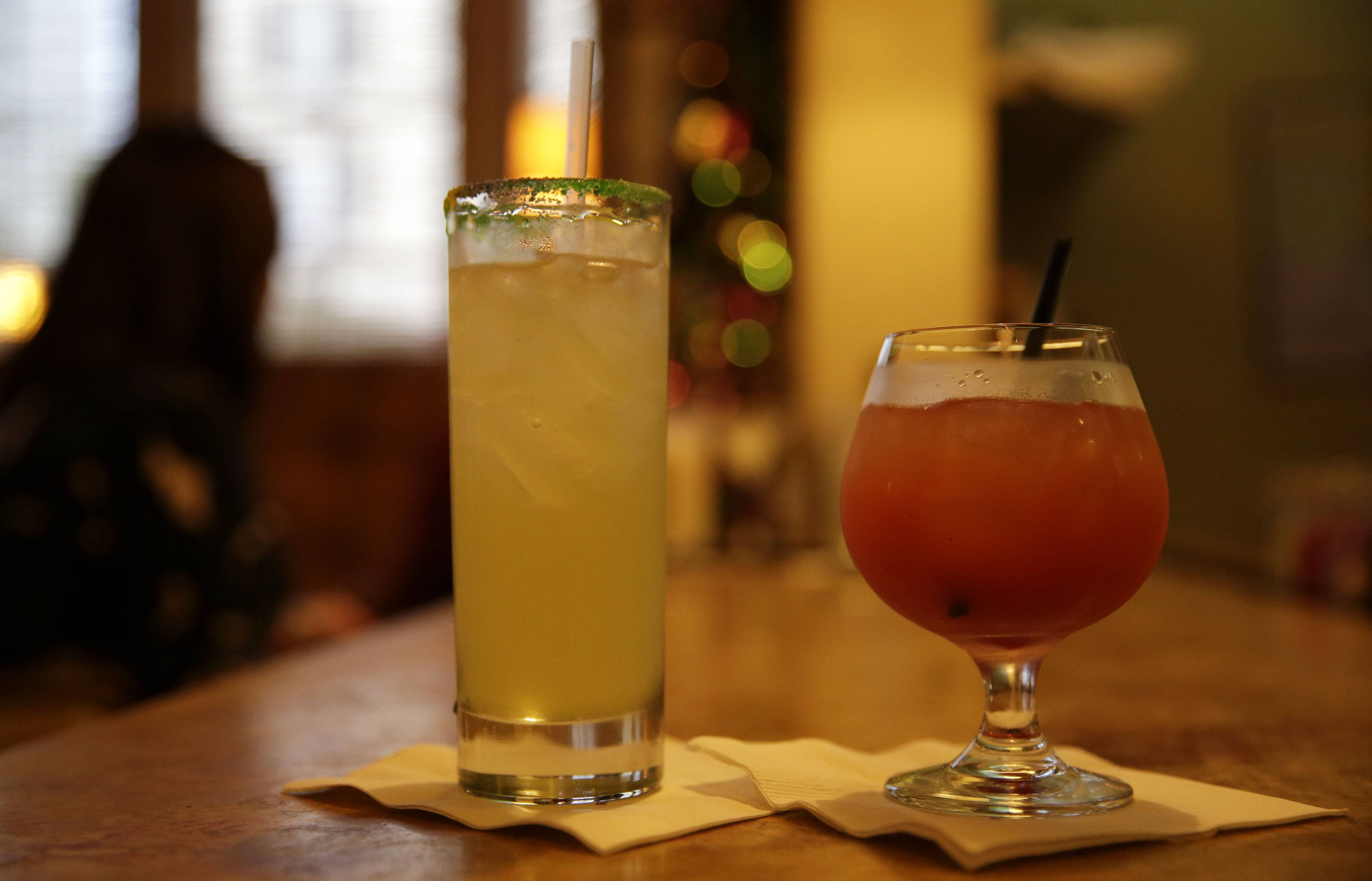 Emeril's Delmonico in New Orleans offers special drinks during Mardi Gras season. The king's cup, left, is made with vanilla vodka, coconut rum, pineapple and prosecco and the Cajun storm is a concoction of New Orleans Cajun Spice rum, house-made grenadine, passion fruit and lemon.