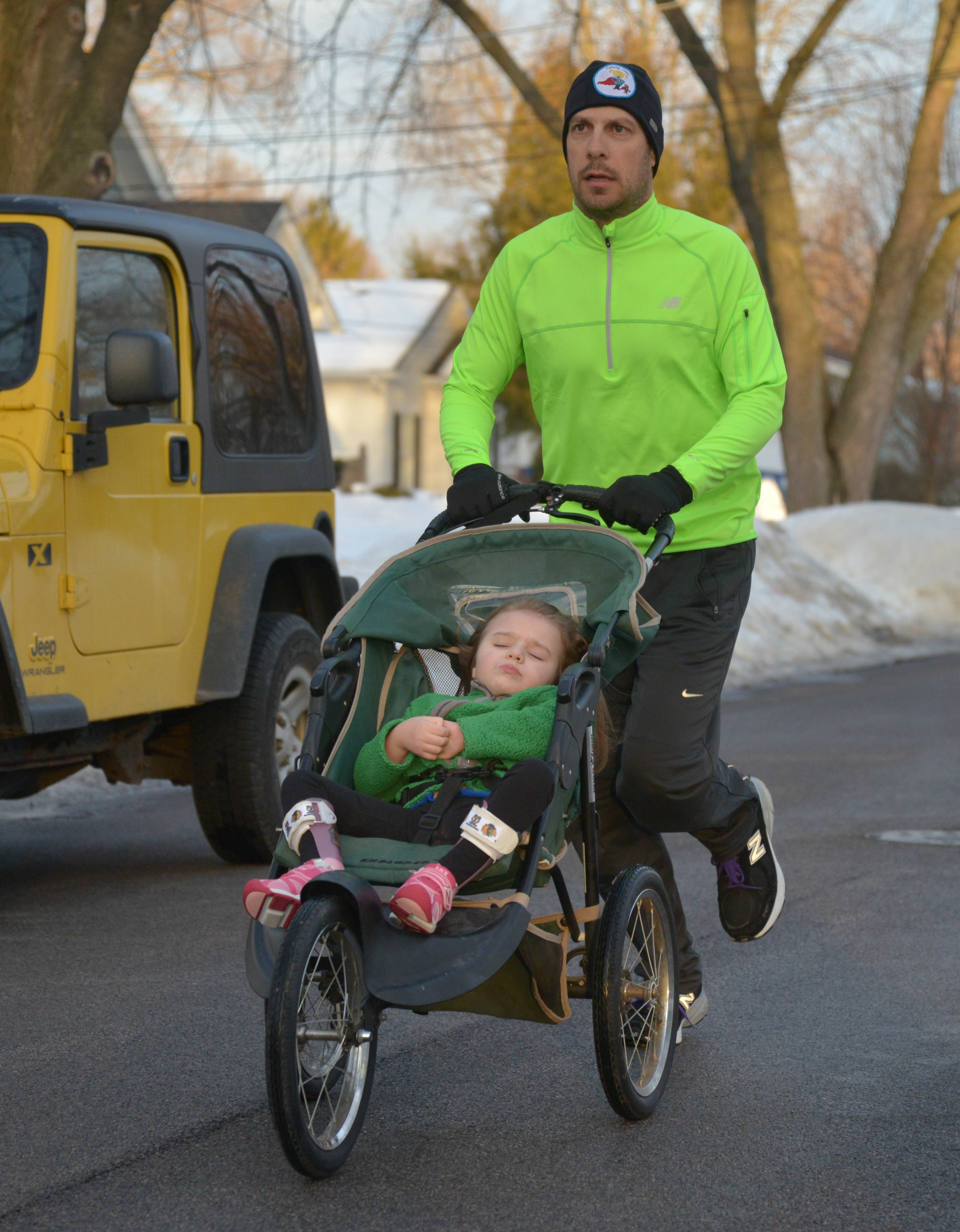 While a bad back forced Bill Babiarz to give up running for a decade, the 34-year-old Wheaton father is training for a 150-mile run next month to raise funds and awareness in the fight against Rett syndrome, a neurological disorder that robs his daughter, Cammy of the ability to walk, talk or control her hands.