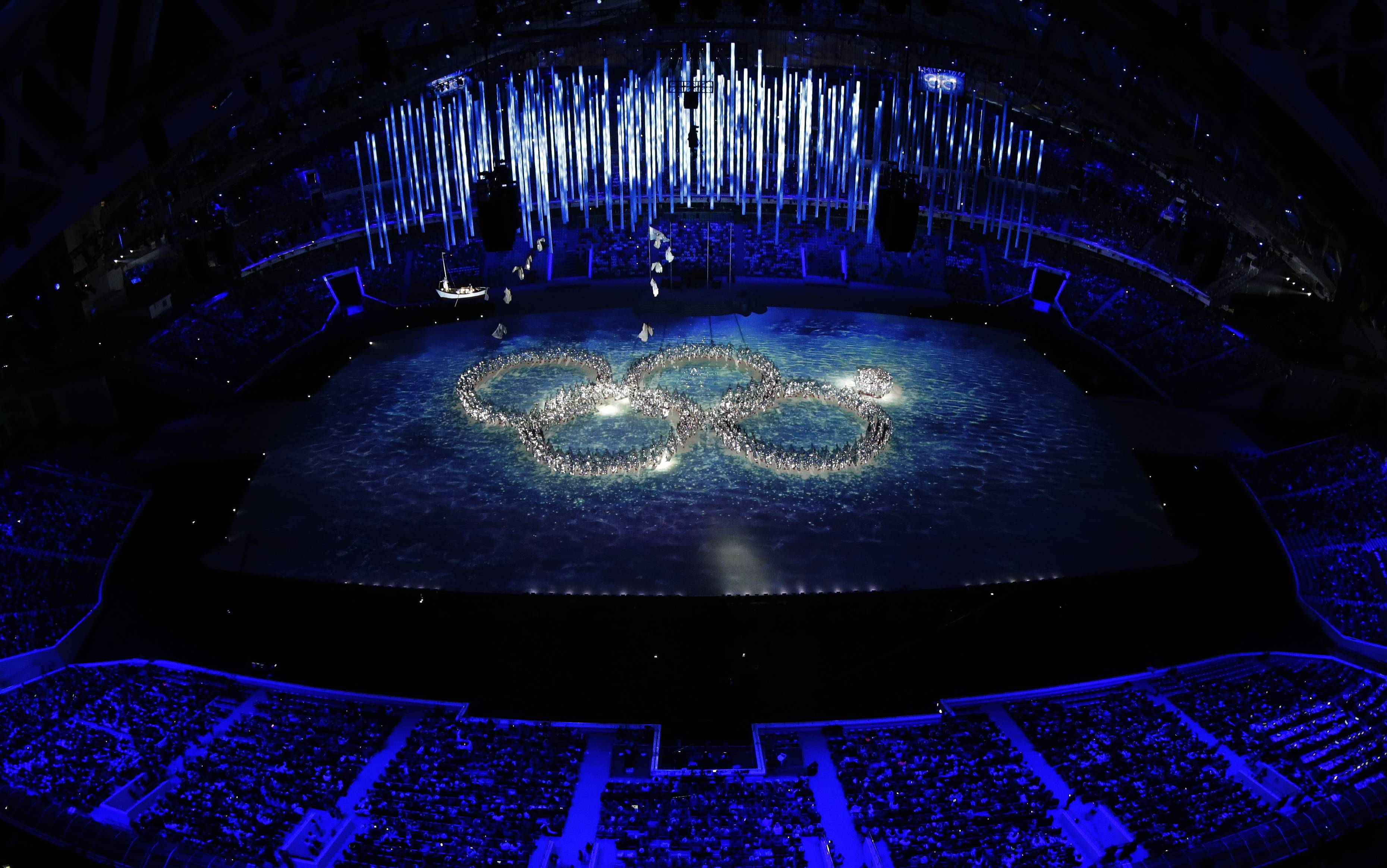 Performers recreate the ring that did not open during the opening ceremony during the closing ceremony of the 2014 Winter Olympics, Sunday, Feb. 23, 2014, in Sochi, Russia.
