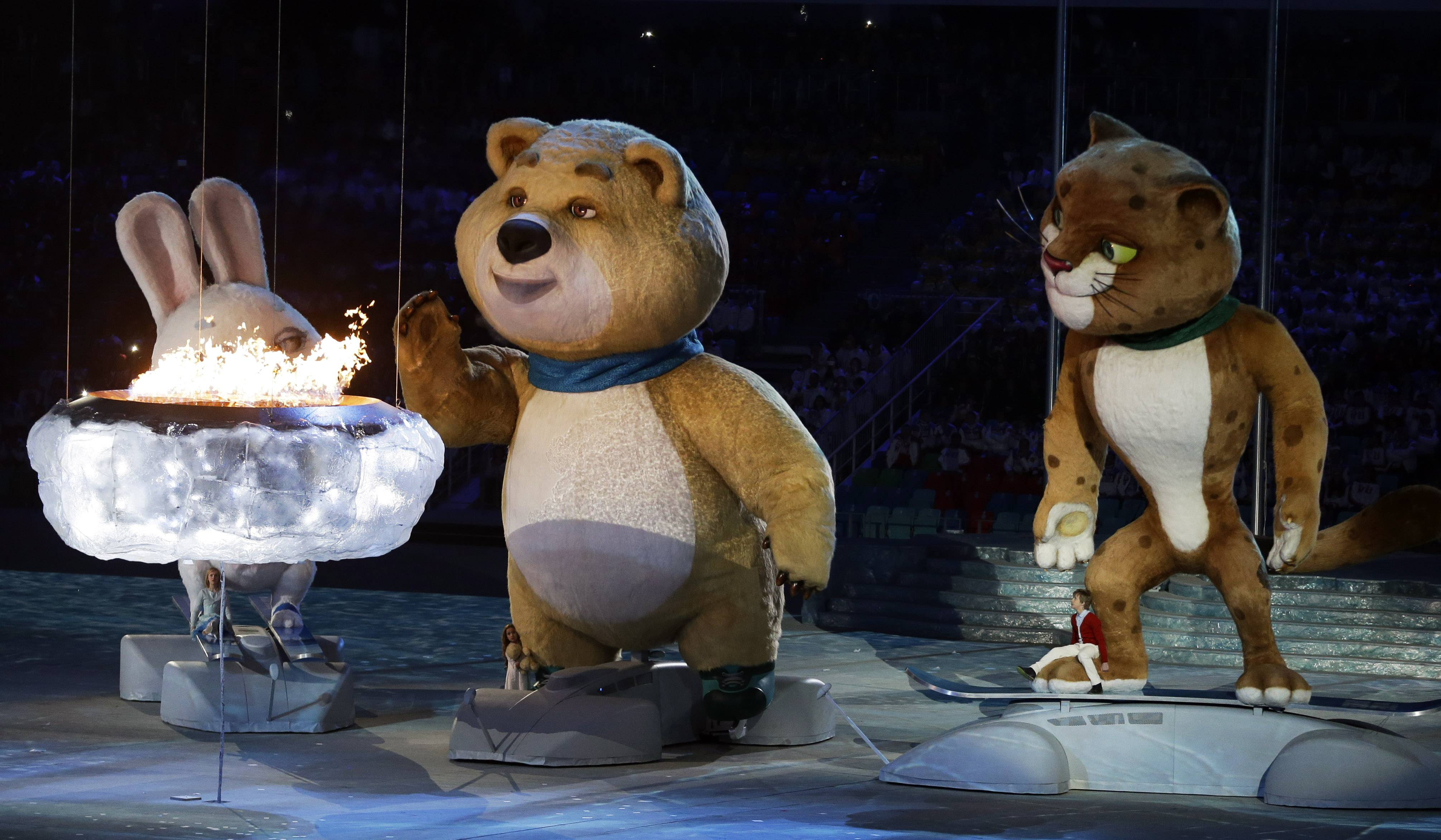 A large mascot blows out the Olympic flame during the closing ceremony of the 2014 Winter Olympics, Sunday, Feb. 23, 2014, in Sochi, Russia.