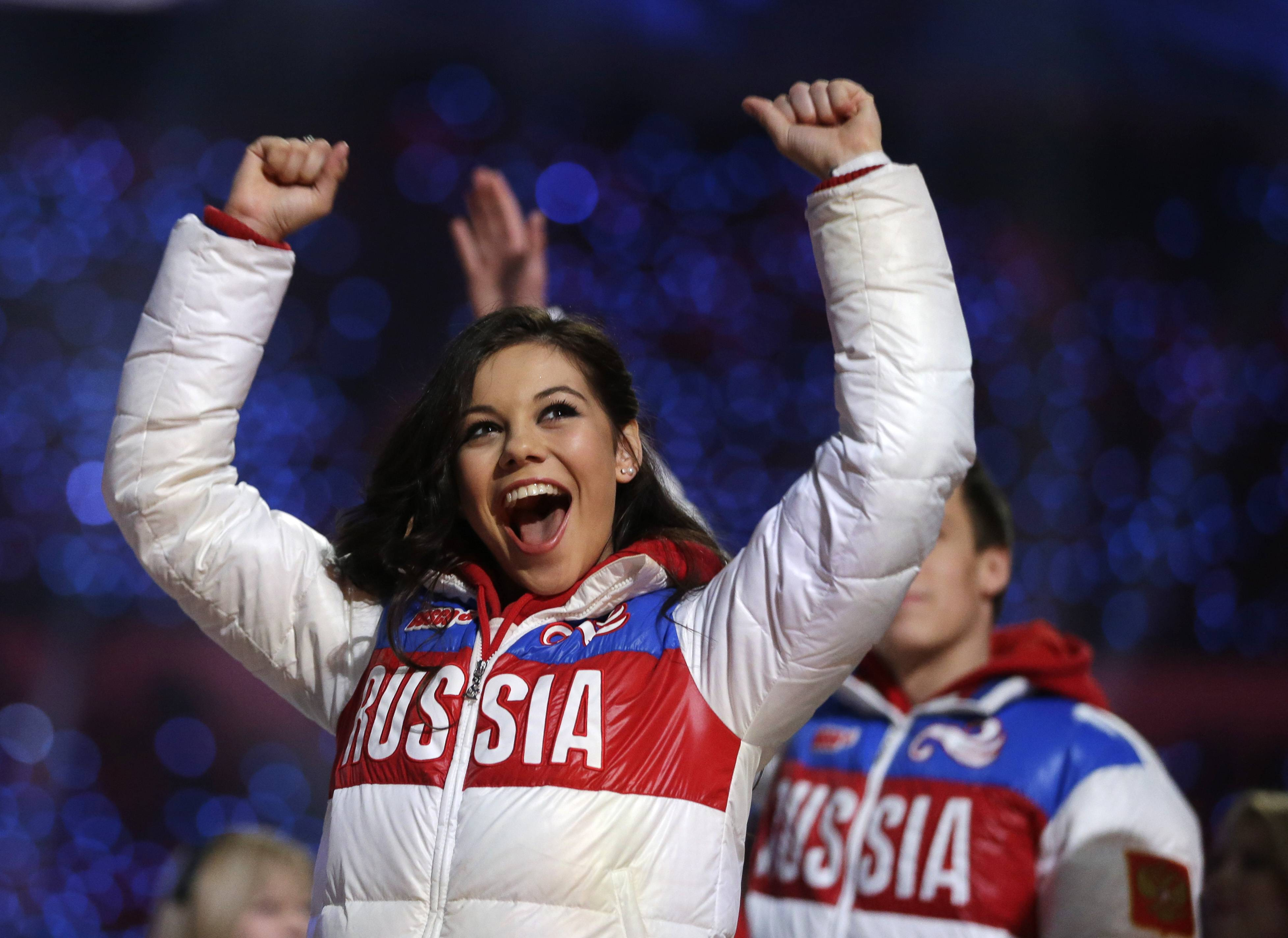 Russian figure skater Adelina Sotnikova waves to spectators during the closing ceremony of the 2014 Winter Olympics, Sunday, Feb. 23, 2014, in Sochi, Russia.