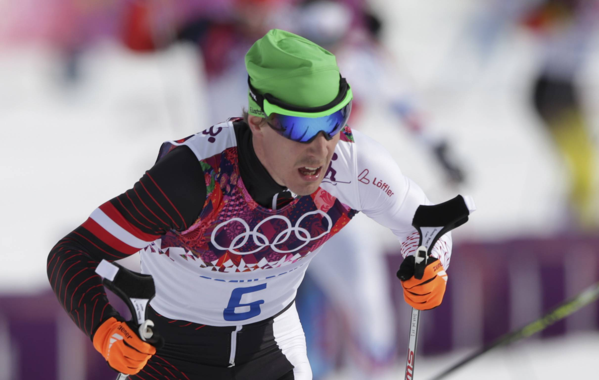In this Feb. 9, 2014 photo Austria's Johannes Duerr competes during the men's cross-country 30k skiathlon at the 2014 Winter Olympics in Krasnaya Polyana, Russia. Duerr has been kicked out of the Sochi Games after testing positive for EPO, the country's Olympic committee said Sunday, Feb 23, 2014. It is the fifth doping case of the Olympics and the first involving the blood-boosting drug EPO.