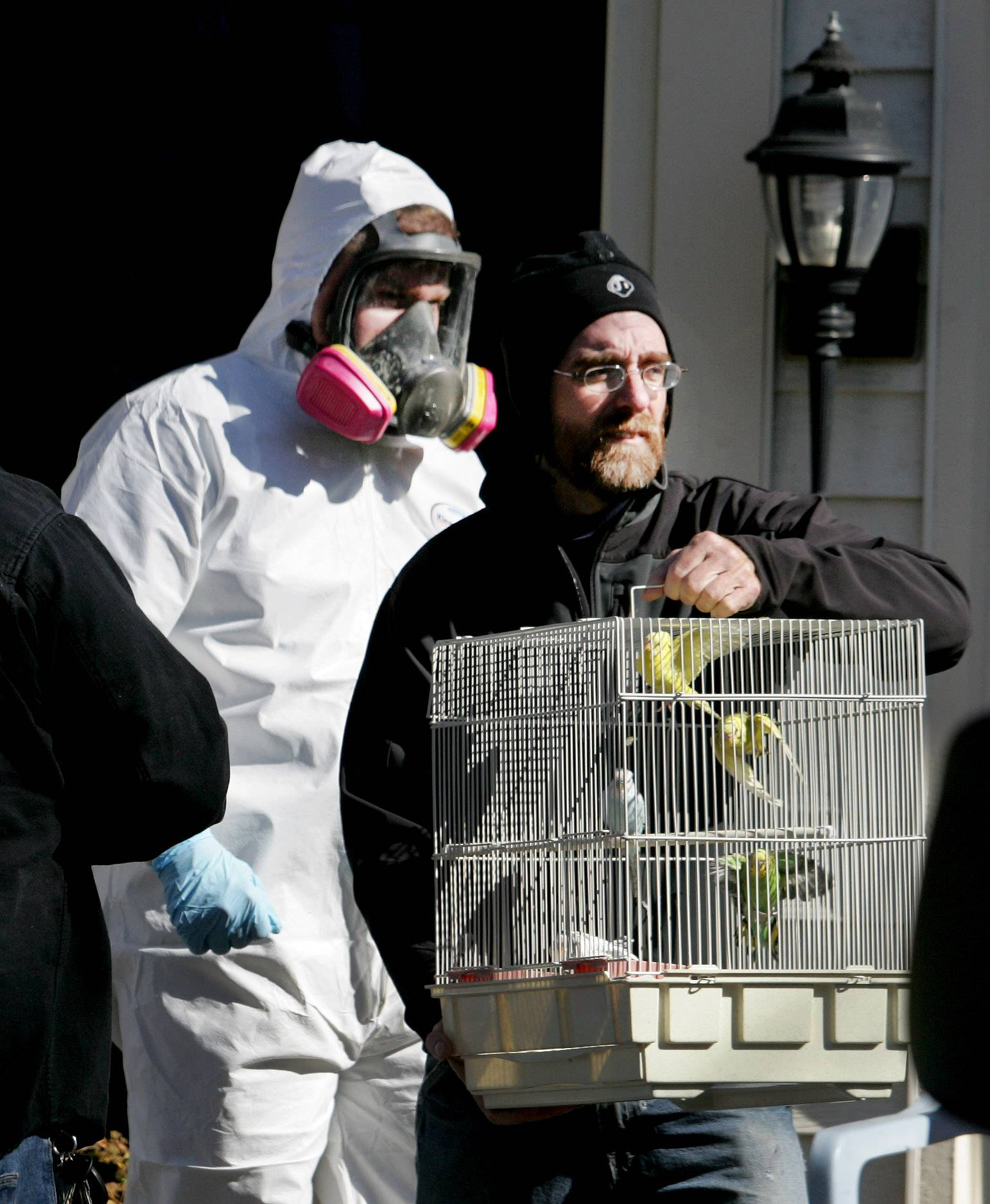The city of Aurora took over the cleanup of the Aurora house of Dave Skeberdis after police found 120 dead birds and 378 in cages or flying about the filth inside in 2012.