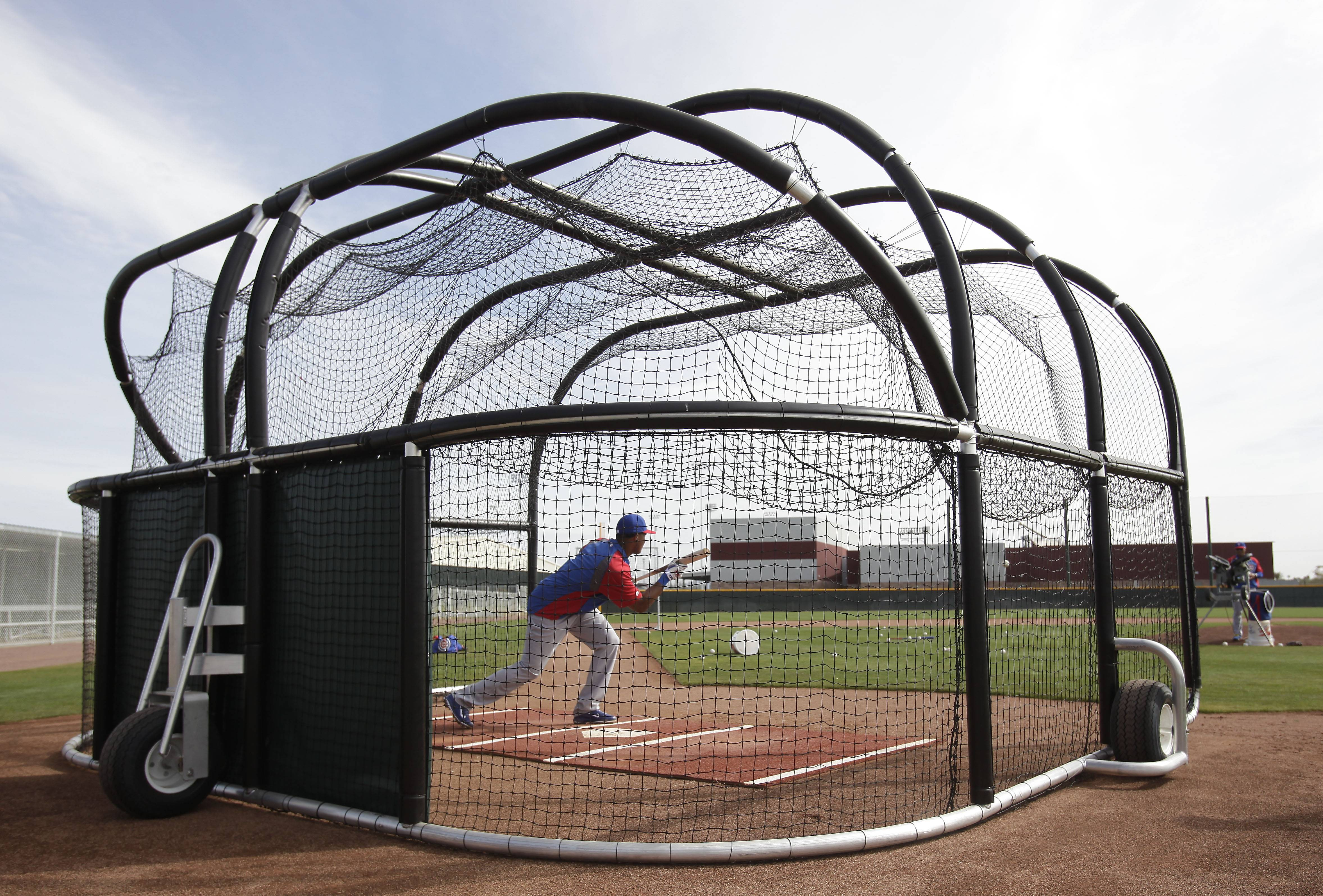 Cubs shortstop Starlin Castro bunts during spring-training practice.
