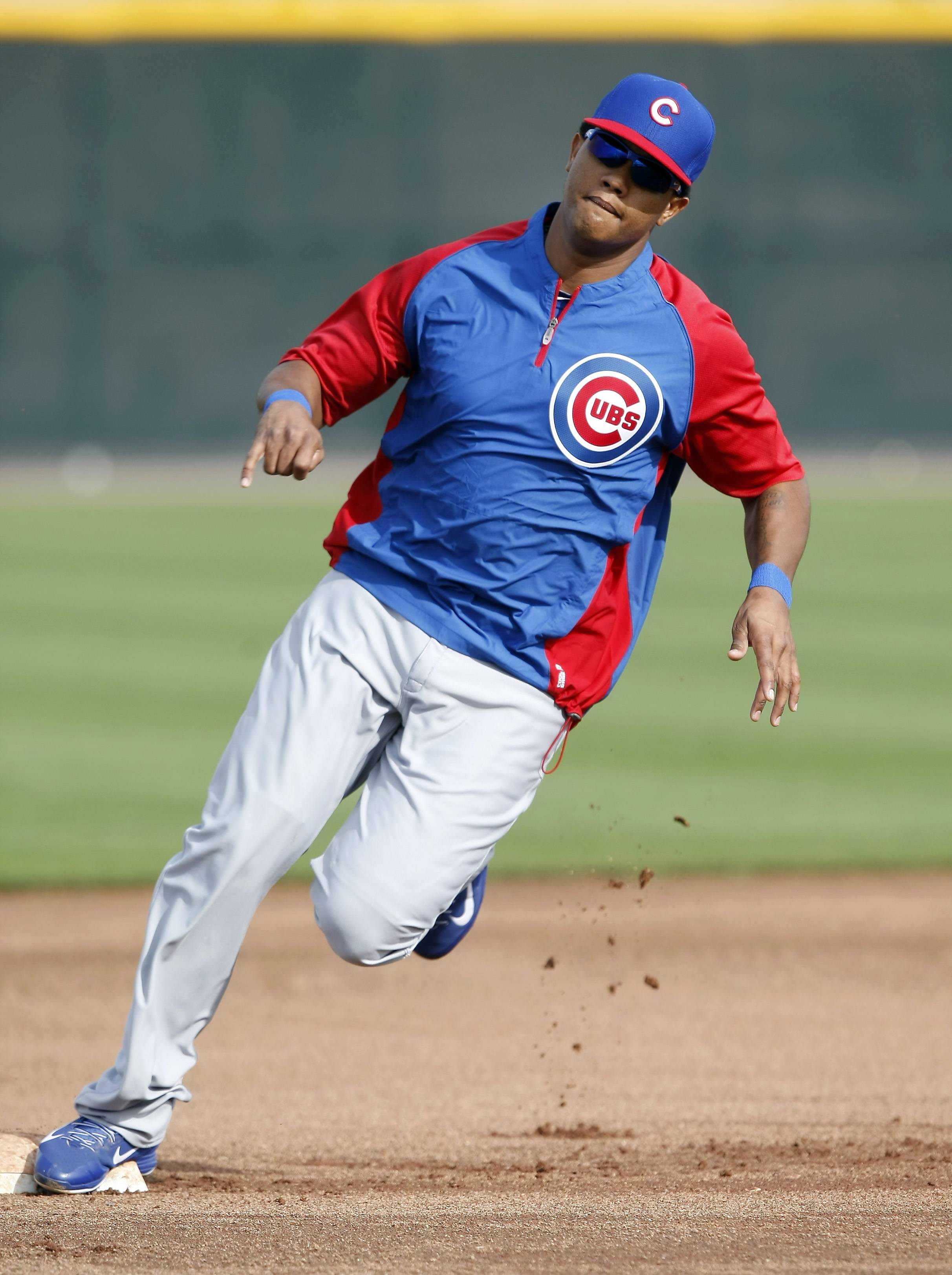Cubs shortstop Starlin Castro runs the bases during spring-training practice in Mesa, Ariz.