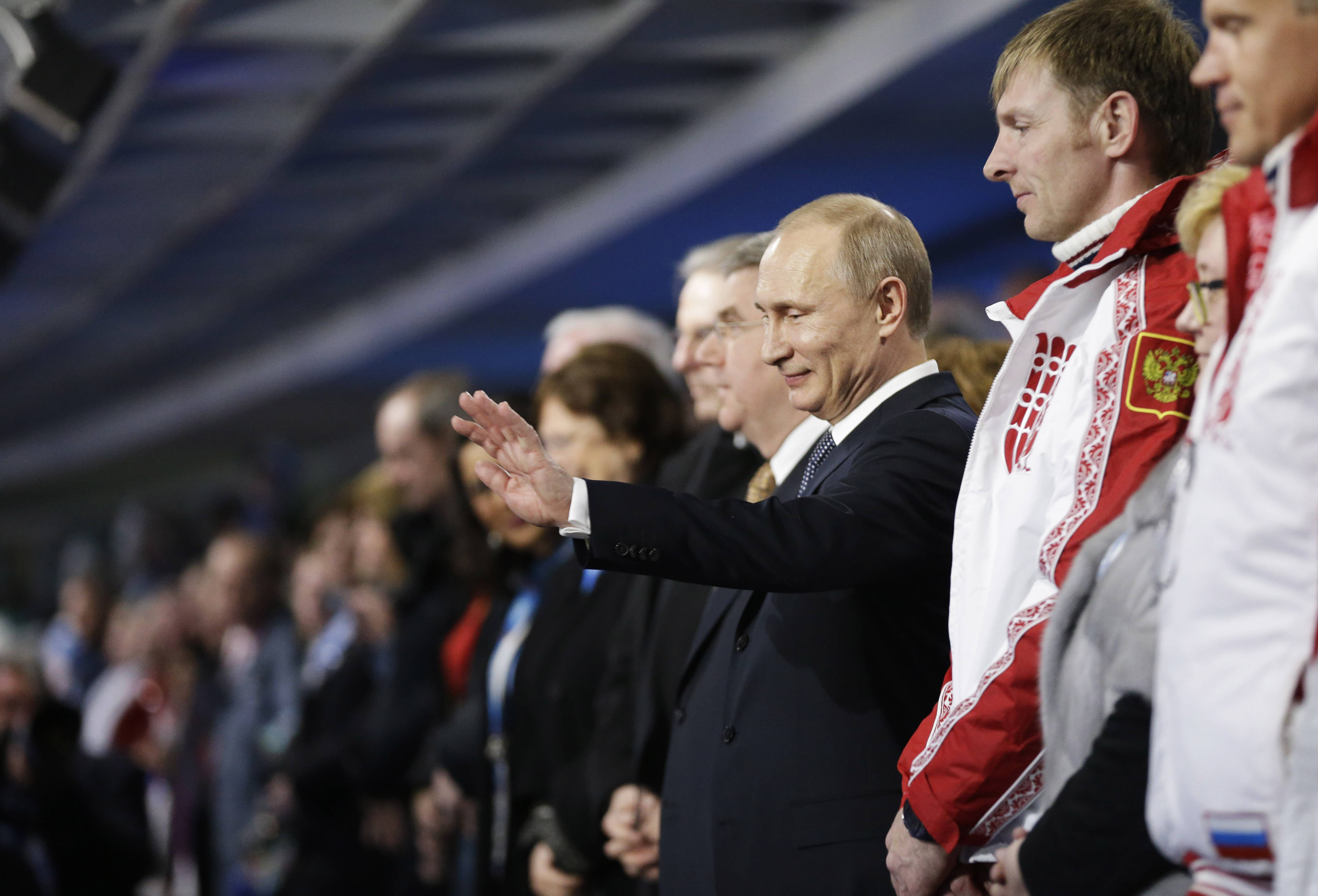 Russian President Vladimir Putin acknowledges the applause of the crowd as he is introduced at the closing ceremony of the 2014 Winter Olympics, Sunday, Feb. 23, 2014, in Sochi, Russia.