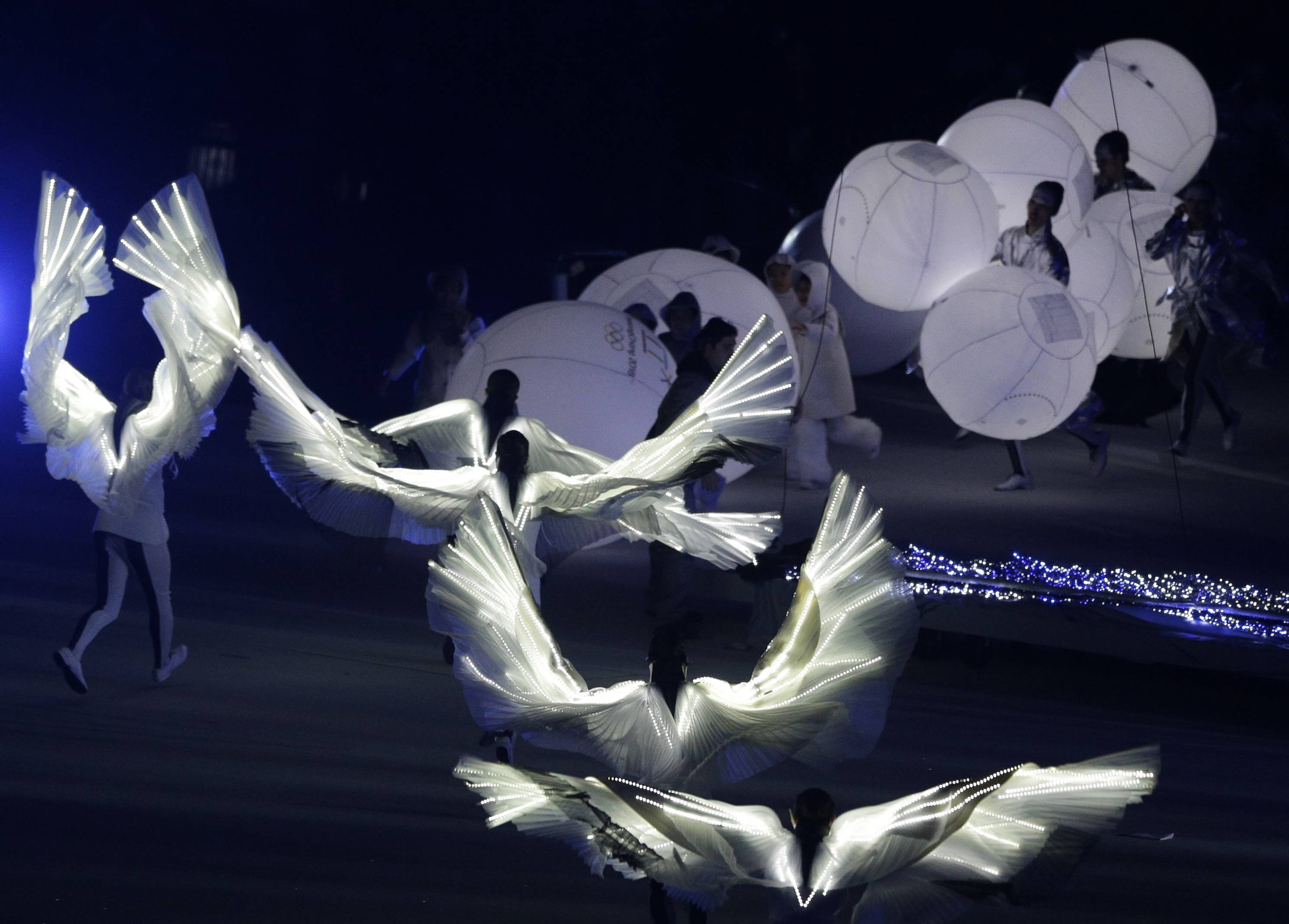 South Korean artists perform during the closing ceremony of the 2014 Winter Olympics, Sunday, Feb. 23, 2014, in Sochi, Russia.