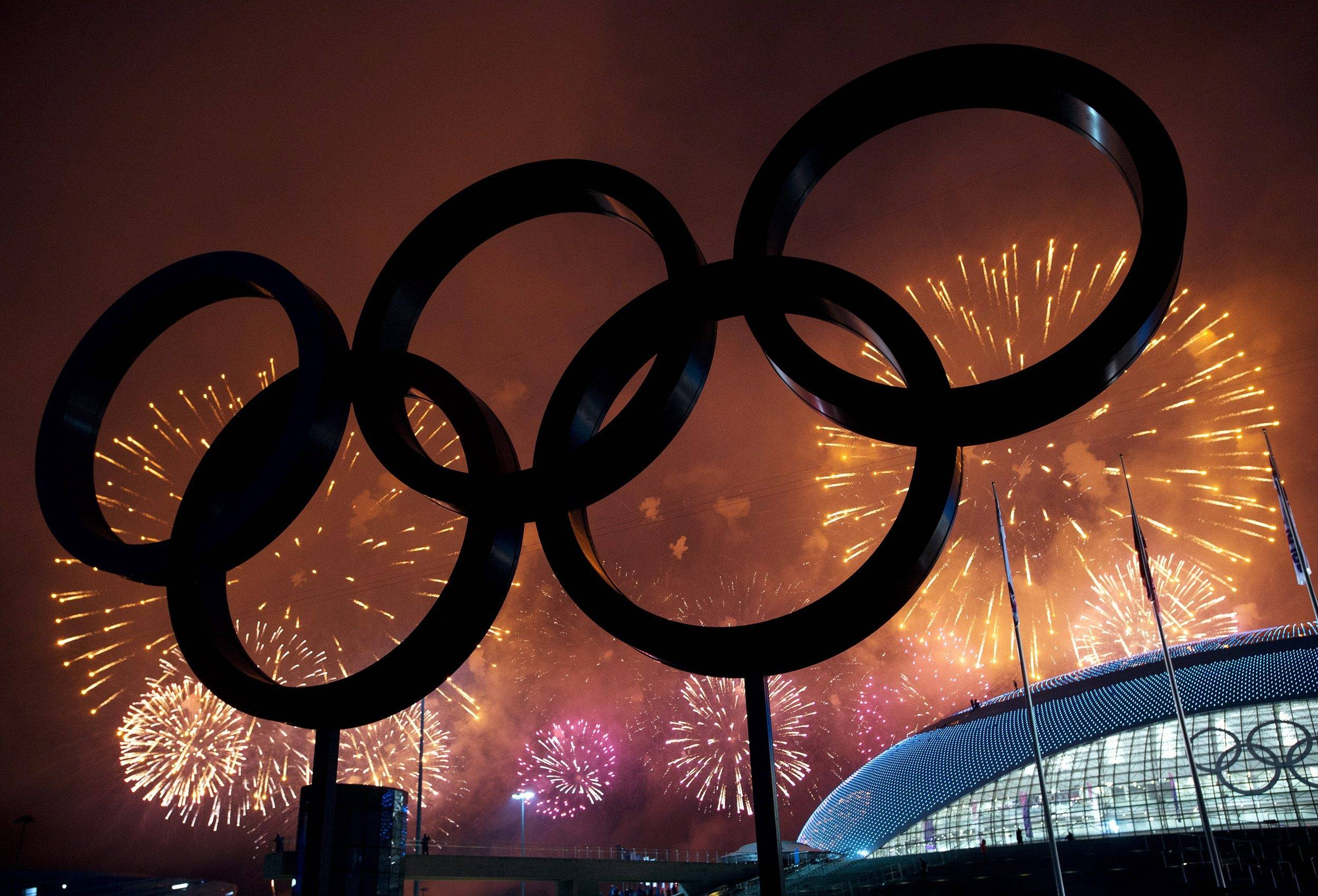The Olympic Rings are silhouetted as fireworks light up the sky during the closing ceremonies at the 2014 Sochi Winter Olympics on Sunday, Feb. 23, 2014, in Sochi, Russia.