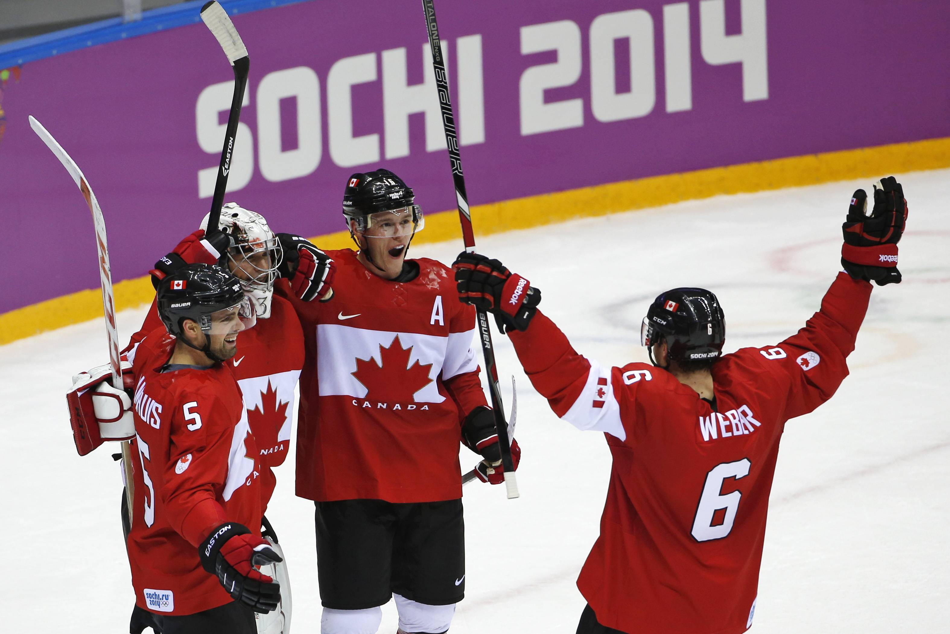 Dan Hamhuis of Canada (5), goalkeeper Carey Price of Canada (31), Jonathan Toews of Canada (16) and Shea Weber of Canada (6) celebrate their 3-0 win over Sweden in the men's gold medal ice hockey game at the 2014 Winter Olympics, Sunday, Feb. 23, 2014, in Sochi, Russia.