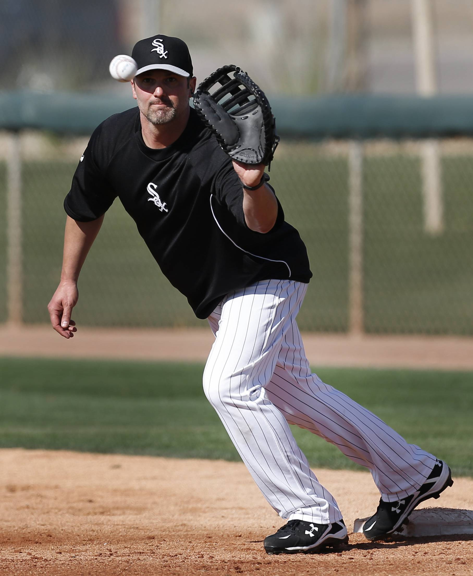 Chicago White Sox first baseman Paul Konerko catches a baseball during baseball spring training in Glendale, Ariz., Saturday.