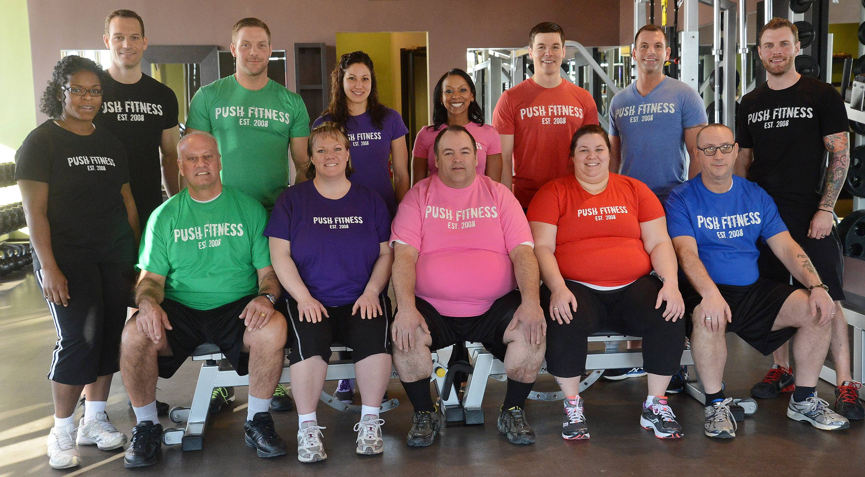 From left, Team Black, Lisa Jones Townsel and Joshua Steckler; Team Green, Chris Kalamatas and Brodie Medlock; Team Purple, Cheryl Seibert and Lindsay Vigna; Team Pink, John Bohanek and Michelle Amsden; Team Red, Allie Monroe and Wade Merrill; Team Blue, Tim Lange and Steve Amsden; and Brad Parotto, boot camp instructor and run club organizer.