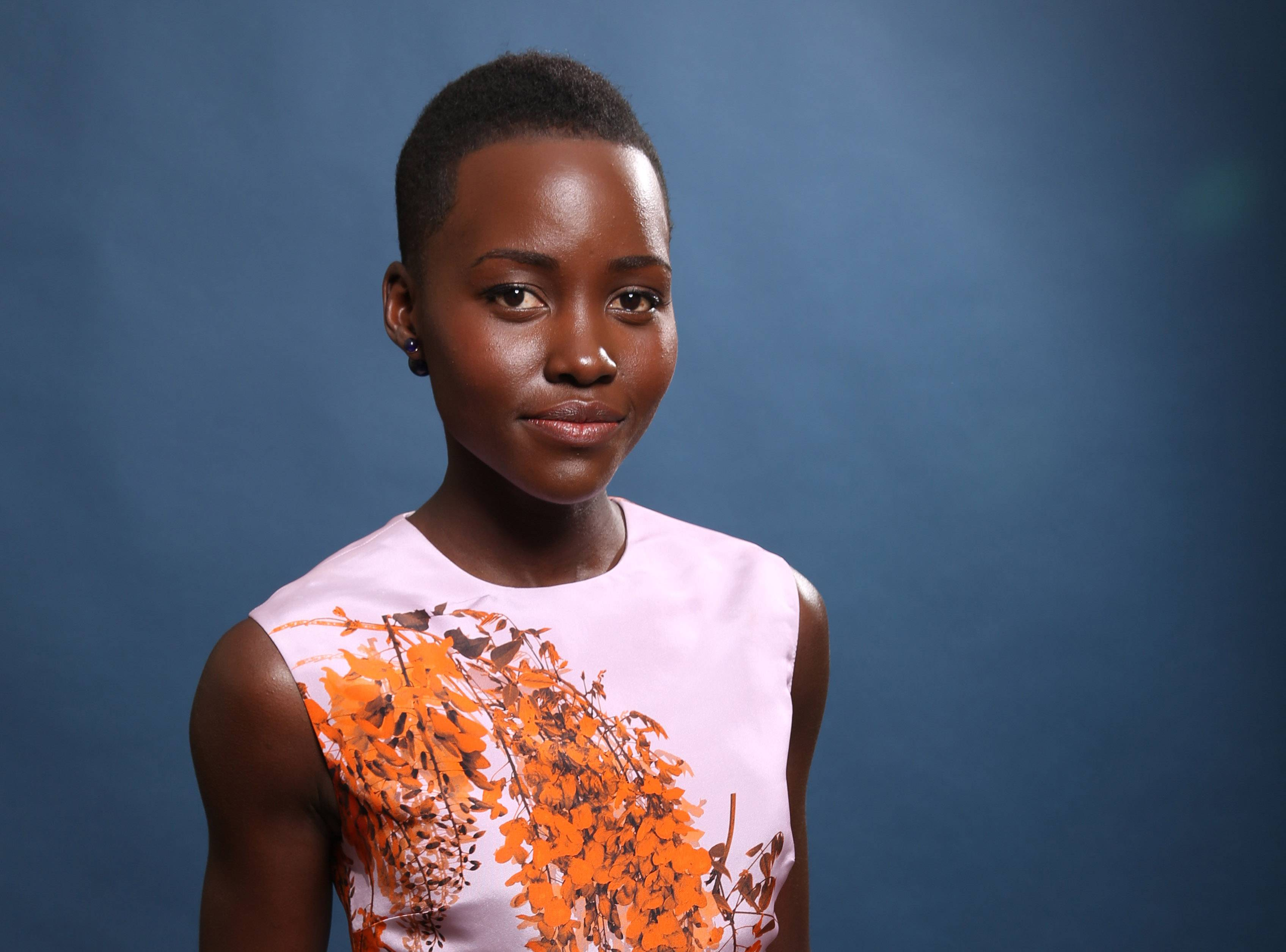 """I try to keep my regimen — rest, water, eat well, workout — so that when this is all over, I don't experience a total hangover,"" says Lupita Nyong'o."