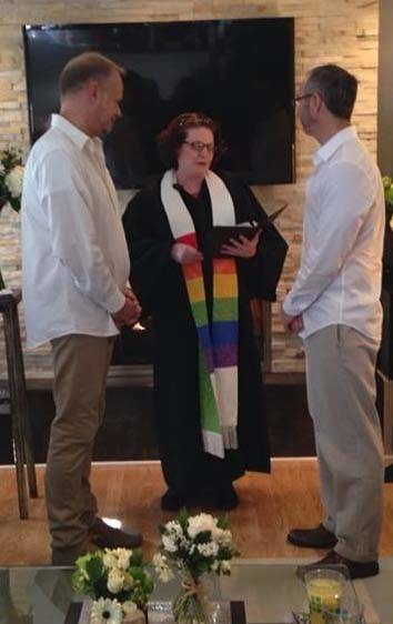 Paul Dombrowski, left, and Joe Serio are married in their Palatine home Saturday by the Rev. Laura McLeod, a friend of the couple.